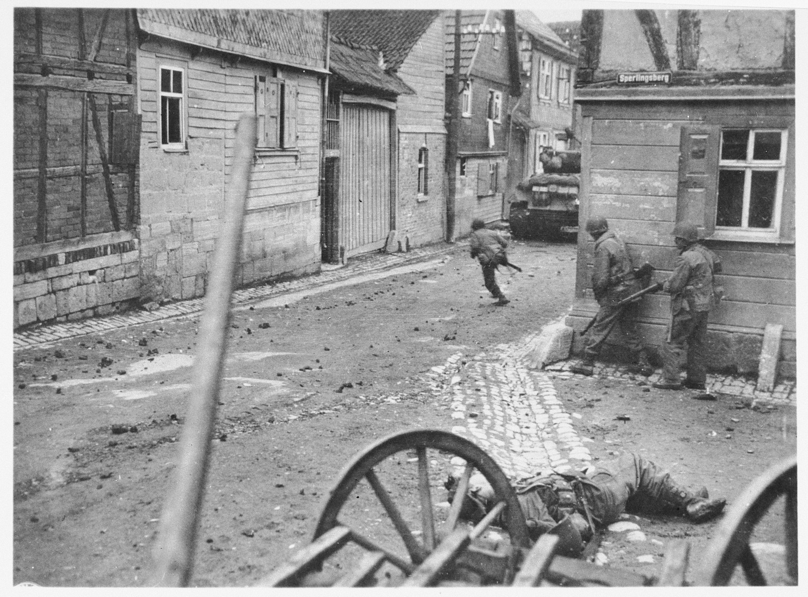 American troops advance through the streets of Aachen during the liberation of Germany.