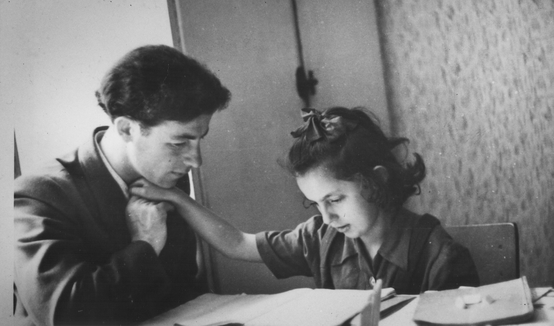 A teacher helps a student to read in a school for Deaf children in Geretsried.