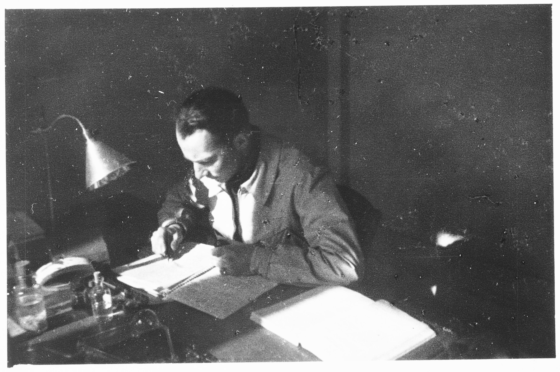 Otto Giniewski (later Etan Guinat), a Zionist activist and leader of the Armée Juive, writes at his desk at the University of Grenoble.
