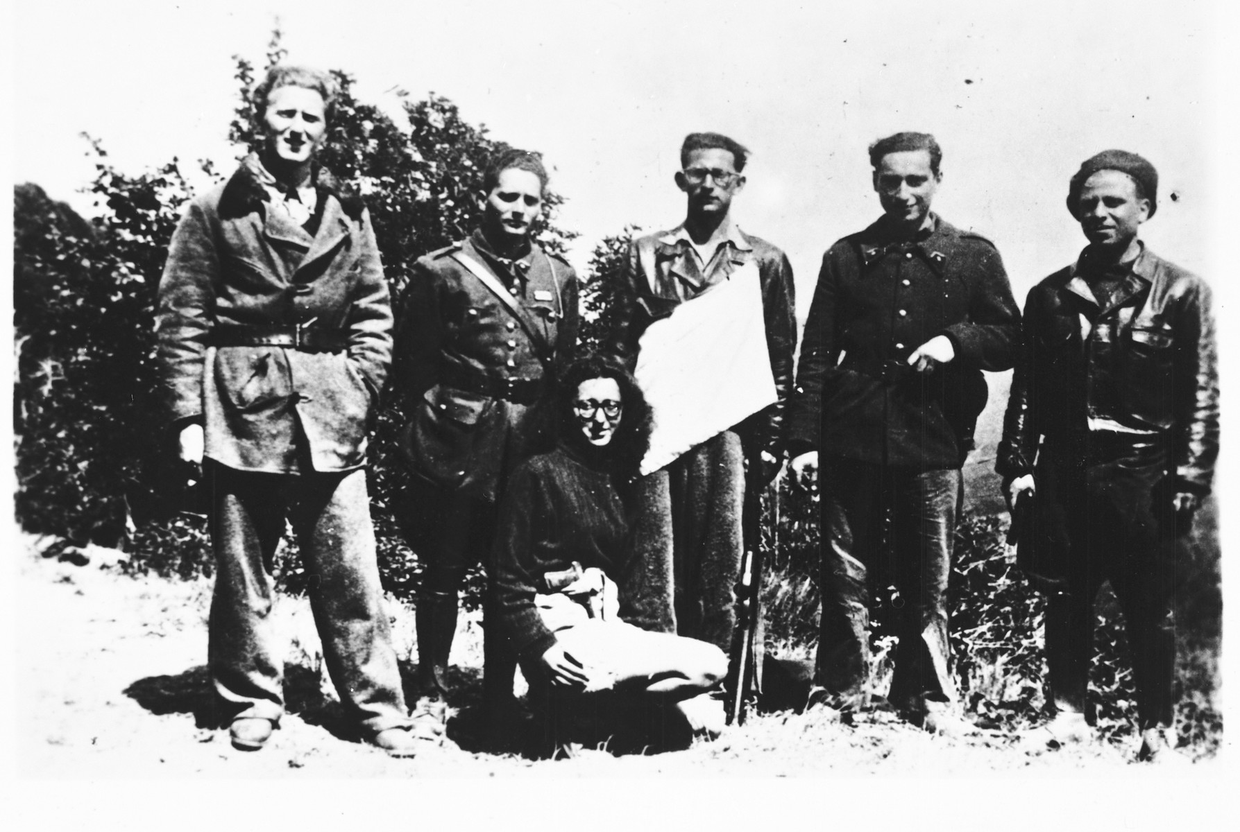 Group portrait of members of the French Jewish resistance group Armée Juive dressed in military uniform.  During the last year of the war, the Armée Juive joined forces with the Maquis resistance.  Among those pictured are Patricia Graff-Rubel (kneeling), and standing from left to right: Jean-Jacques Fraicent (Frayman), Jacques Lazarus (Jacquel) who served as the AJ's military instructor, Henri Broder, Pierre Loeb and Albert Cohen (Bebe).