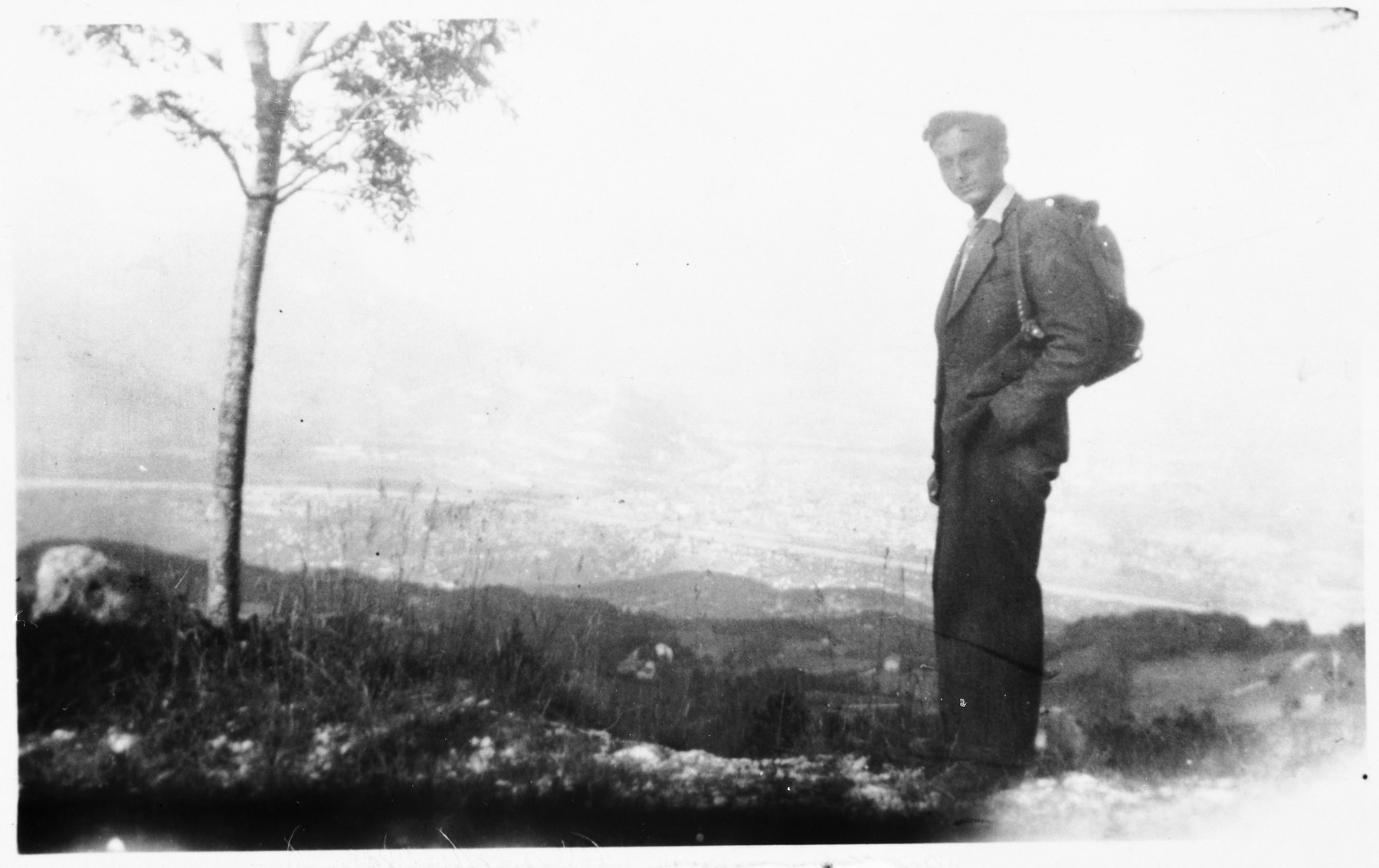 A member of the French Jewish resistance group Armée Juive, poses outside wearing a rucksack on the eve of his escape across the border into Spain.  Pictured is Arthur Einhorn.