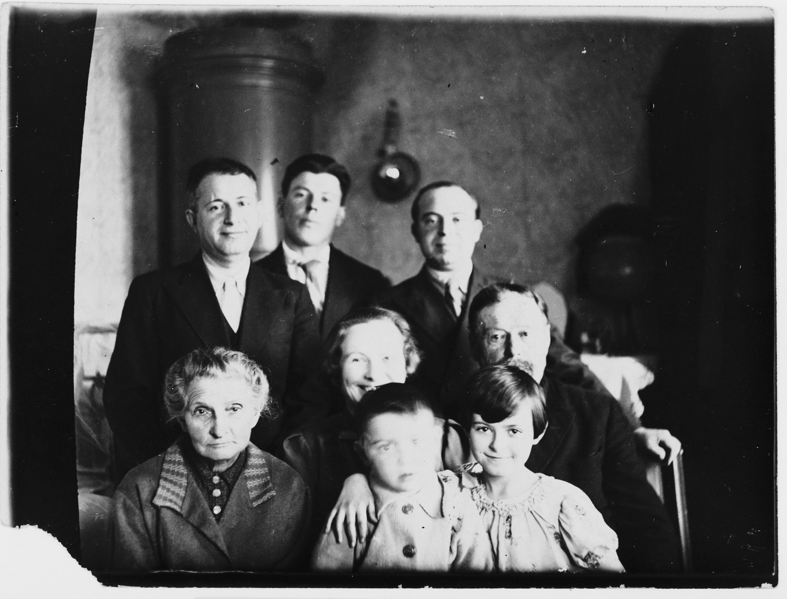 Portrait of the Schneidman and Shpuntov families in their apartment in Leningrad.  Sitting left to right are Maria Leibman, baby Maria, Galina Schneidman, Maria Shpuntov-Golba and Tanfel Shpuntov.  Standing are Ilya Schneidman, Yousek Shpuntov and Simon Golba.
