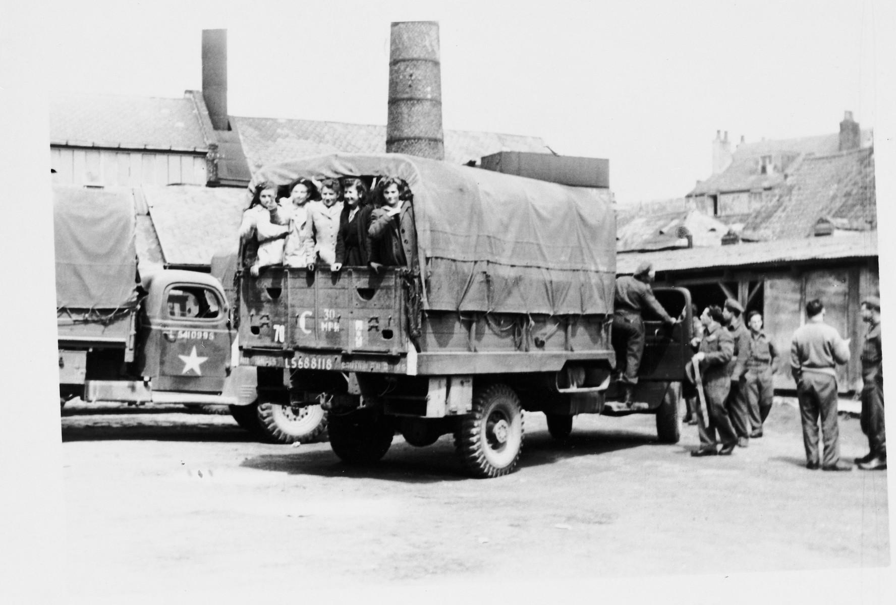 Jewish Brigade soldiers transport Jewish DPs by truck in The Netherlands.