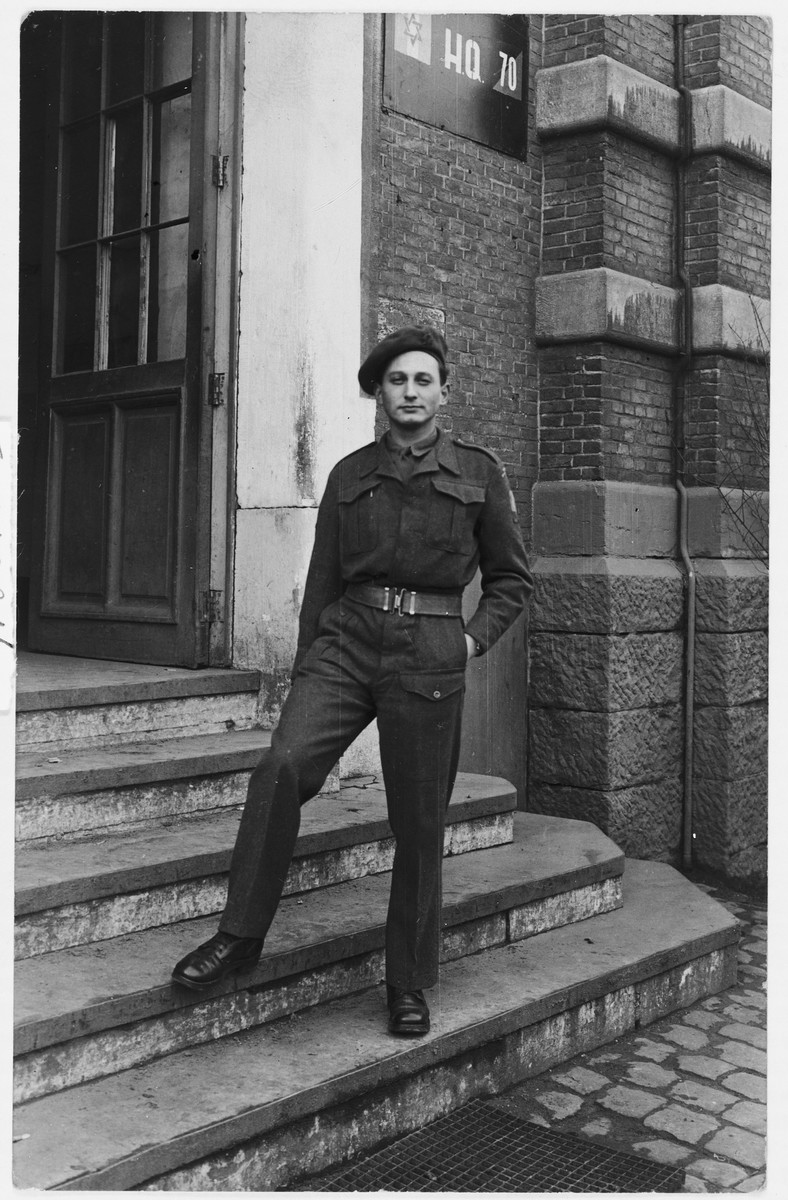A Jewish Brigade soldier poses at the entrance to Brigade headquarters in The Netherlands.  Pictured is Arthur Einhorn.