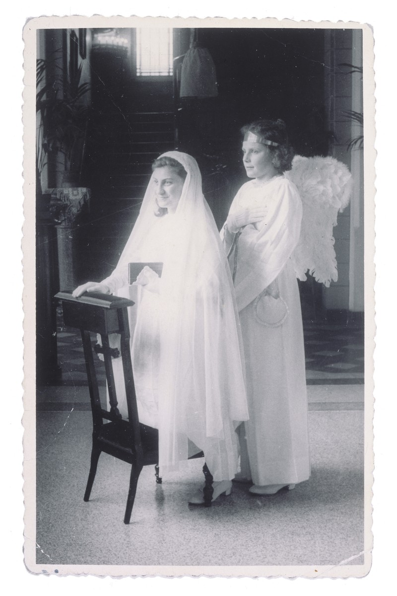 Portrait of a Jewish child in hiding on the day of her First Communion at the Soeurs de Sainte Marie convent school in Wezembeek-Oppem near Brussels.    Pictured on the left is the donor, Sara Lamhaut, living under the assumed name of Jeannine van Meerhaegen.