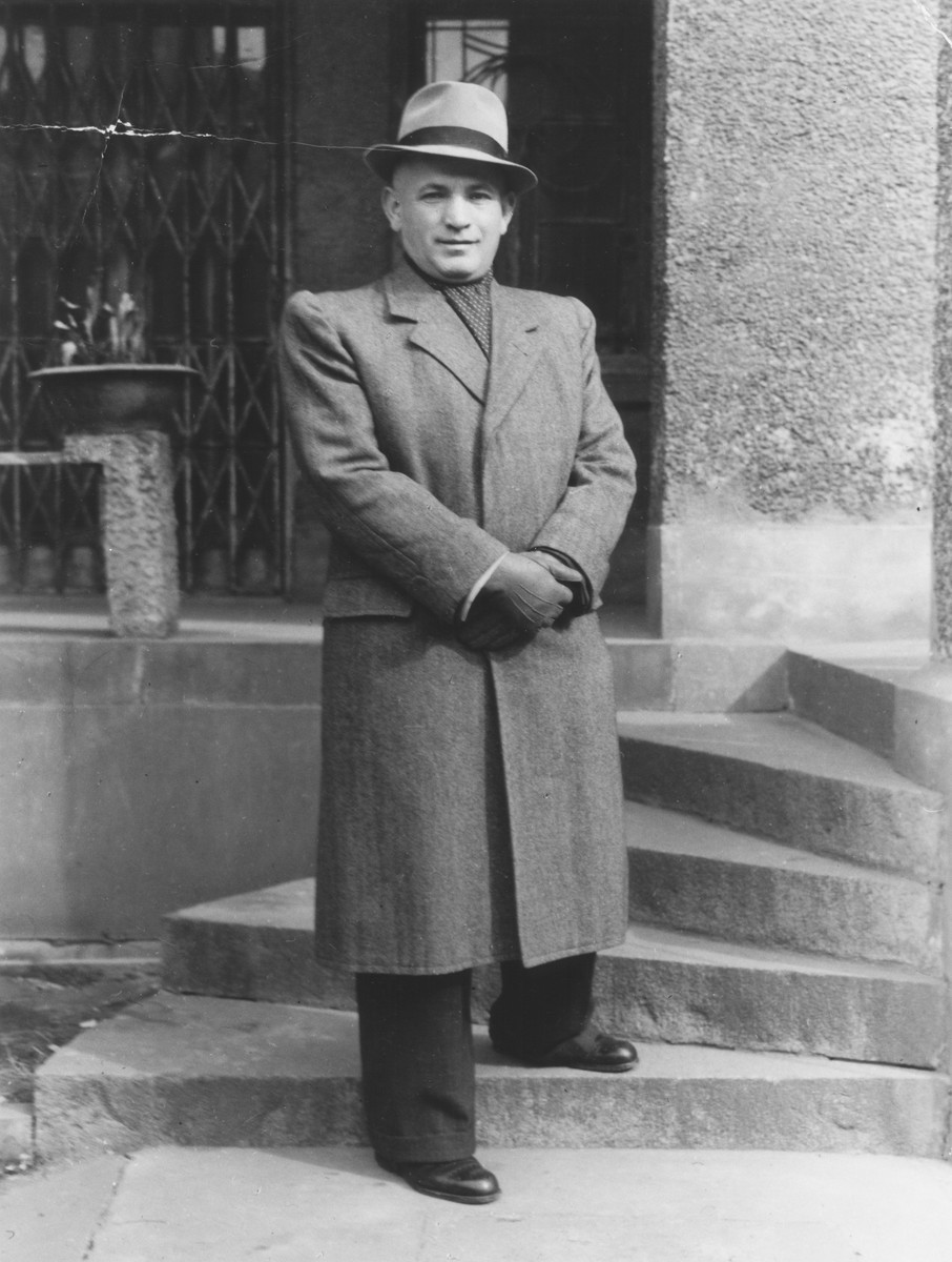Jakob Uszerowicz stands on the steps to a building in Shanghai.