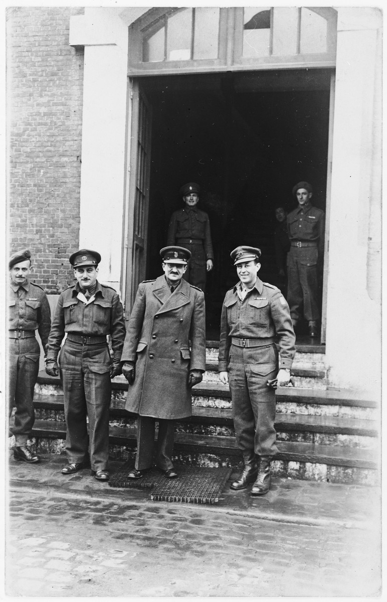 Members of the Jewish Brigade stand at the entrance to their headquarters in The Netherlands.  Pictured in the center is Brigadier Ernest Benjamin, commanding officer of the Jewish Brigade.