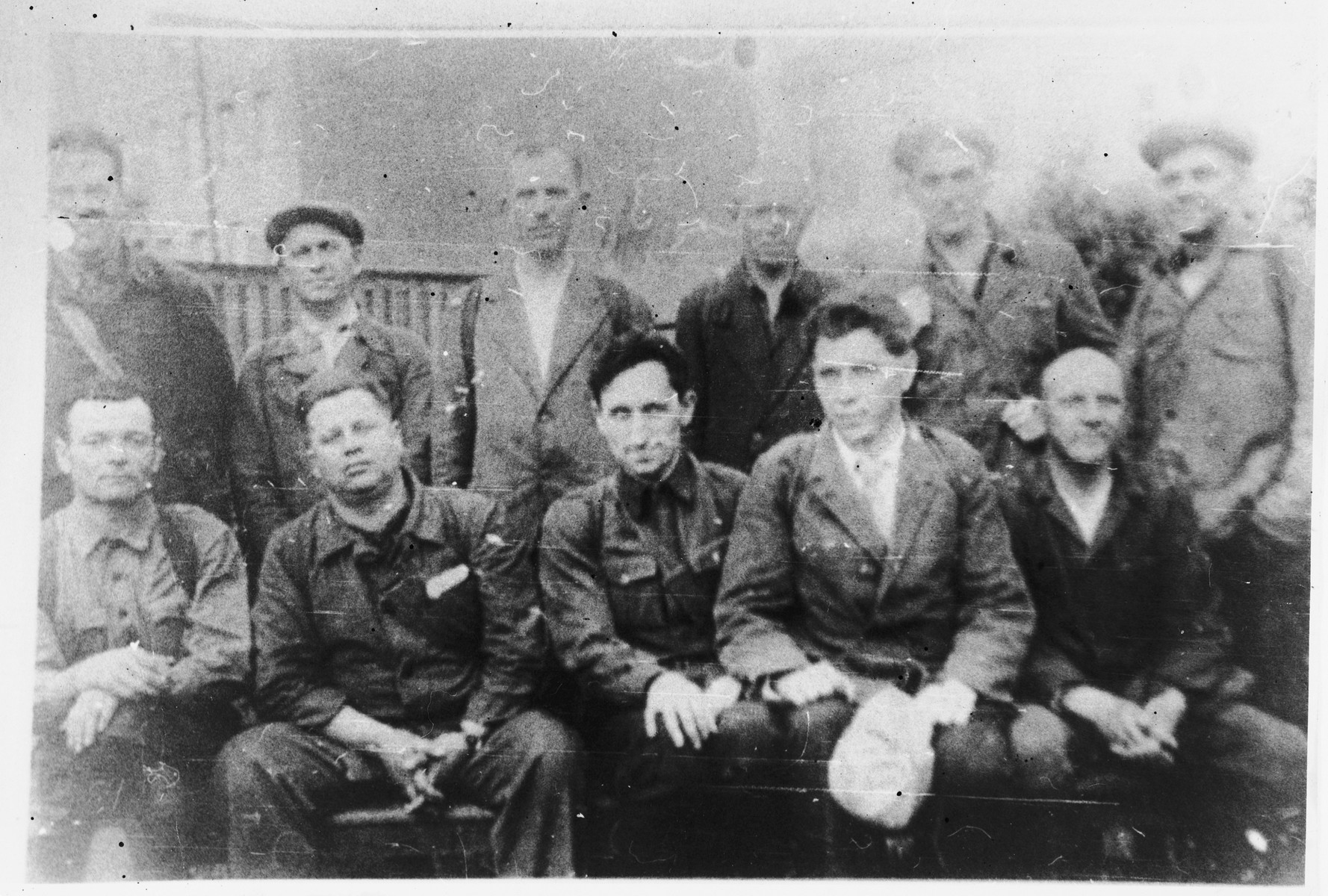 Group portrait of volunteers of the civil guard stationed in Khatnezha, outside of Leningrad.  Among those pictured is Ilya Schneidman (back row, second from the left).
