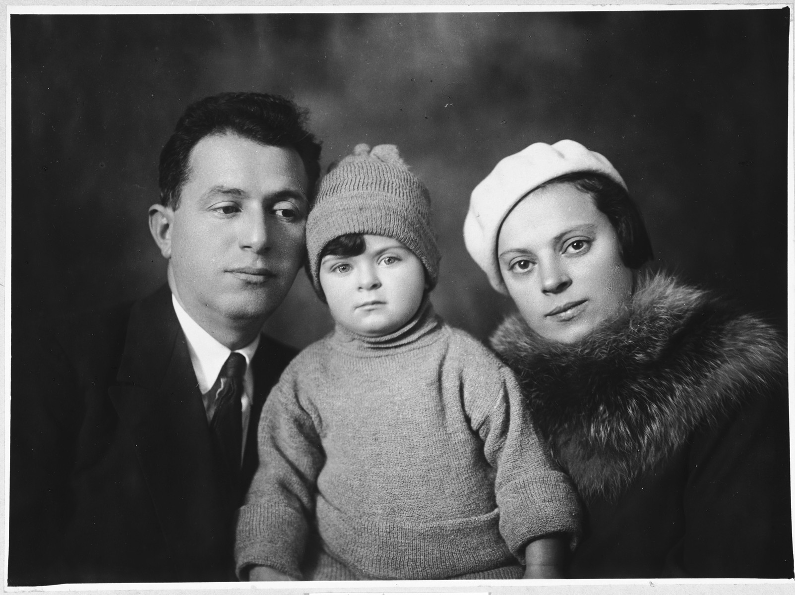 Portrait of the Schneidman family.  From left to right are Ilya, Galina and Maria (Malka) Schneidman.