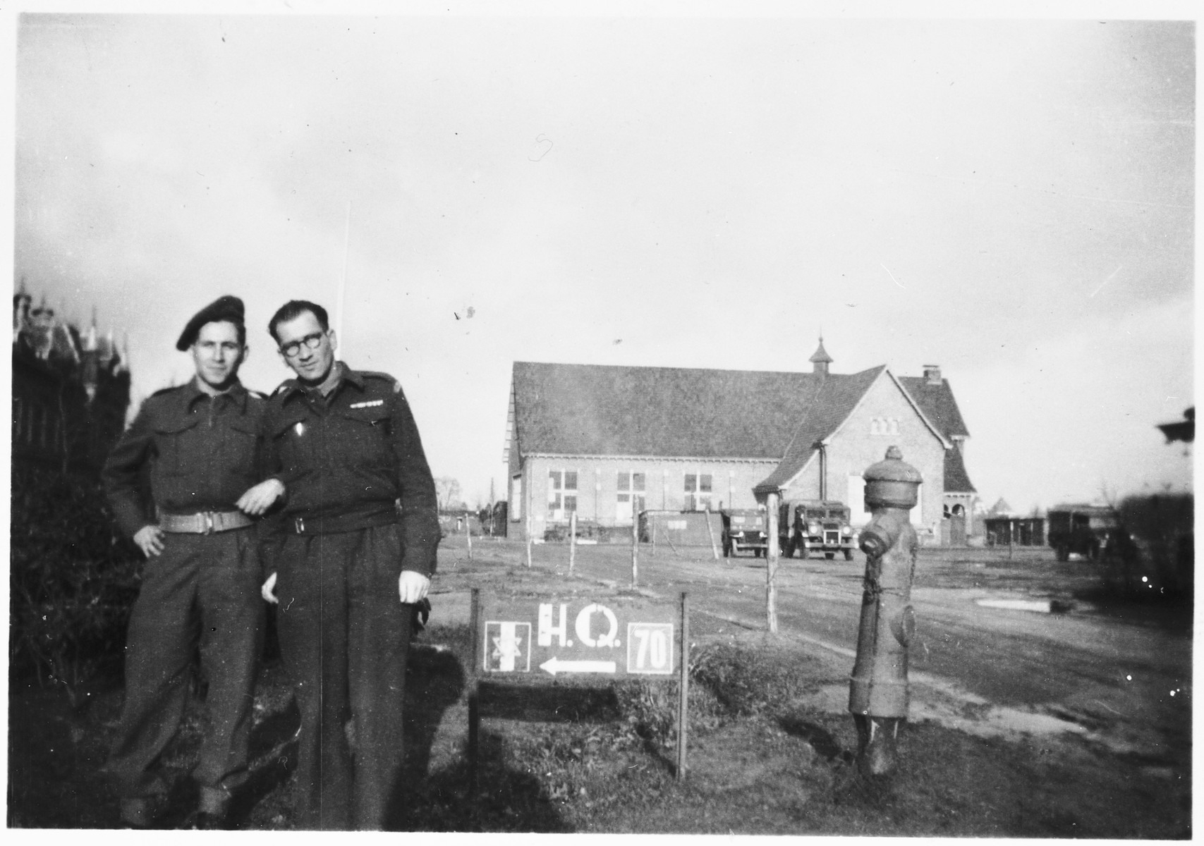 Two Jewish Brigade soldiers pose outside their headquarters in Breda, Holland.
