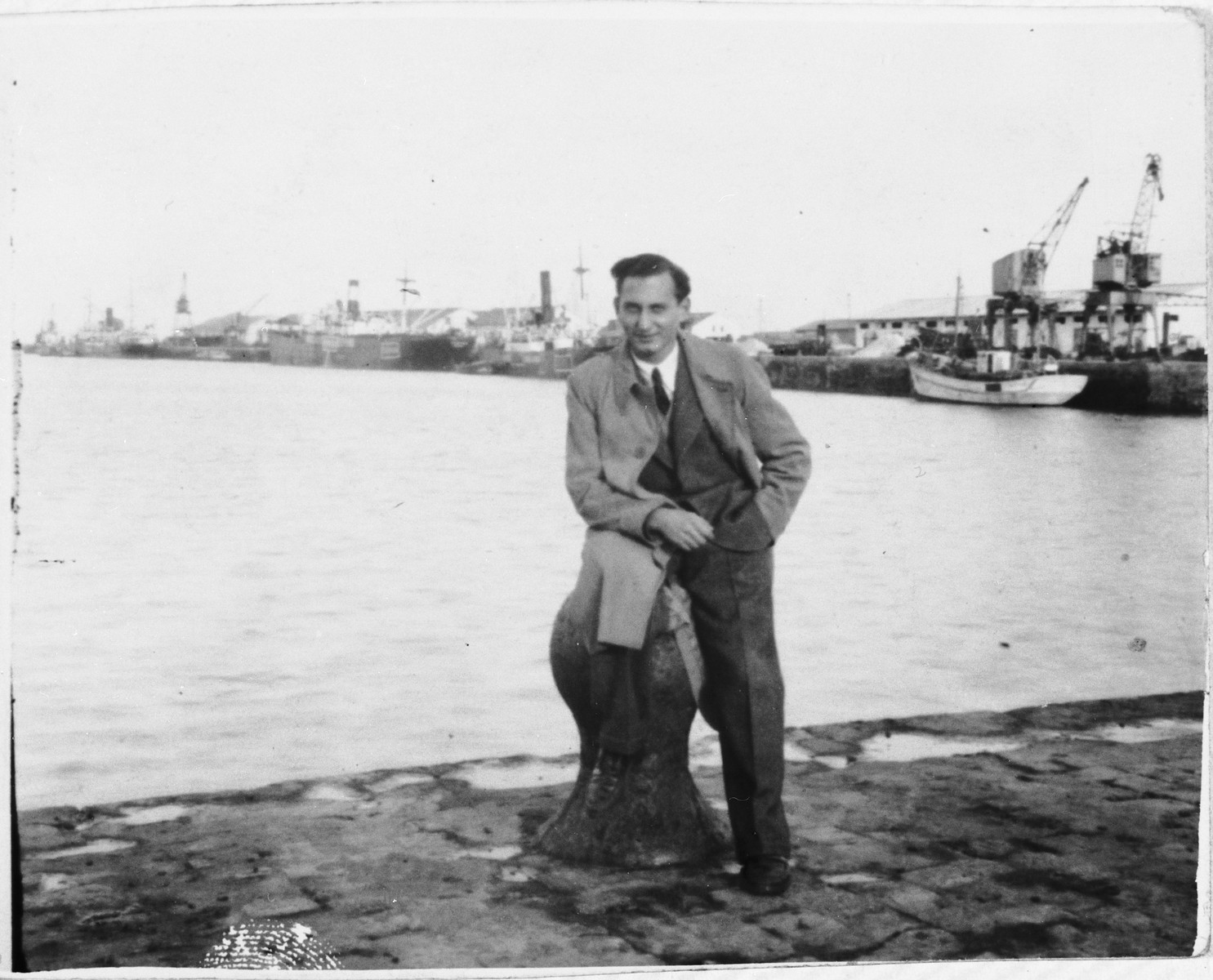 Jewish refugee Arthur Einhorn poses at the port of Cadiz before boarding the SS Nyassa for Palestine.