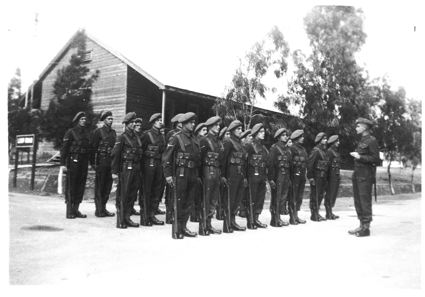 A unit of Jewish recruits to the British army in Palestine stand in formation on their base in Sarafand.  Among those pictured is Arthur Einhorn.