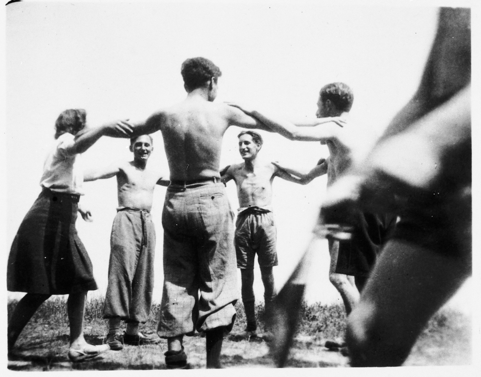 Members of Armée Juive dance a horah in their training camp in the Alps.