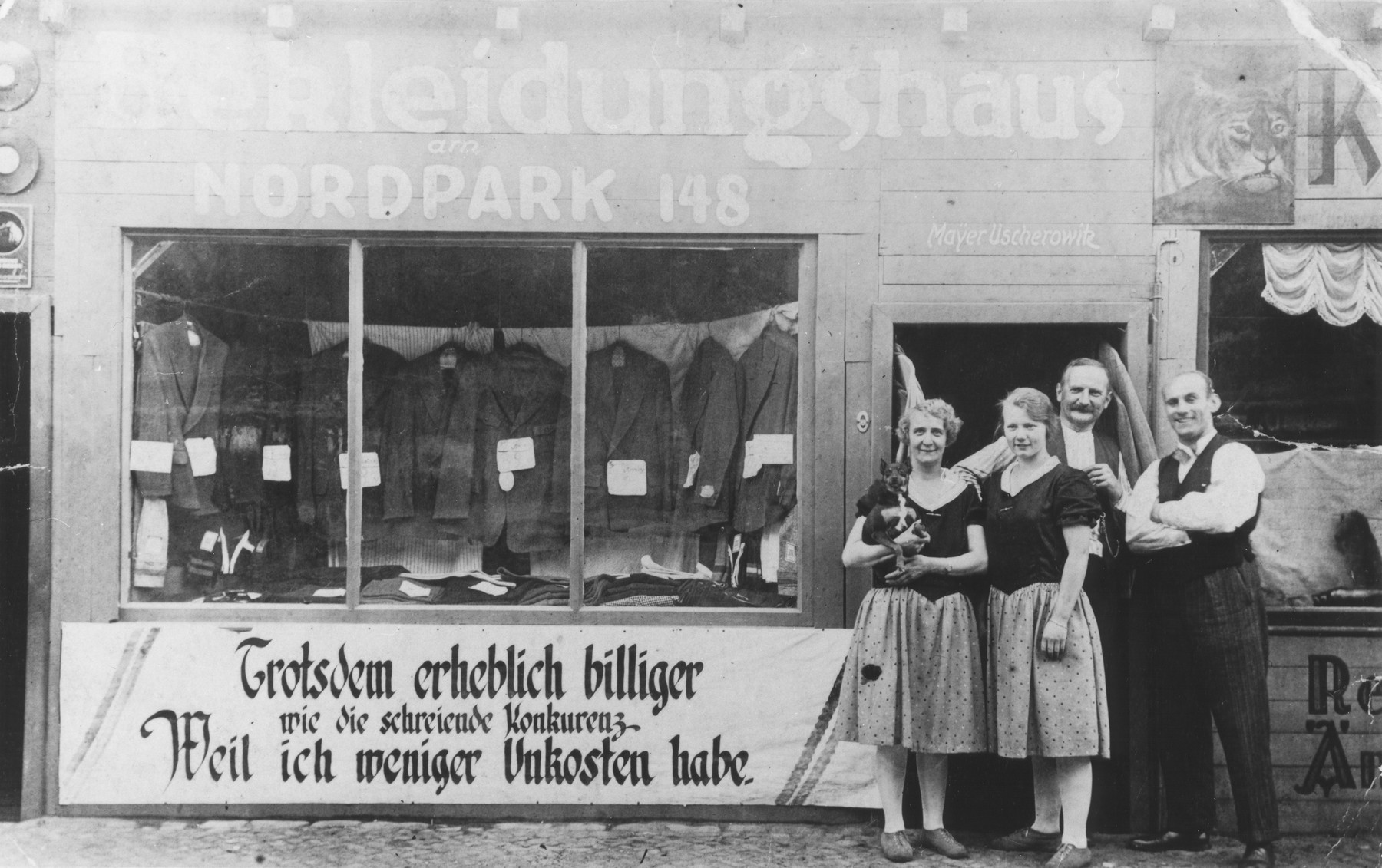 Kajla and Jakob Uszerowicz and another couple stand outside their clothing store in Berlin.