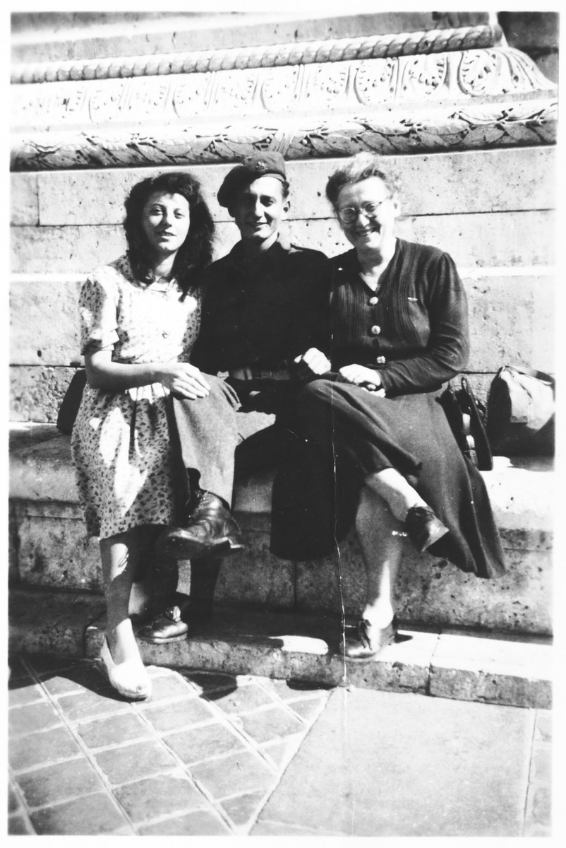 A Jewish Brigade soldier is reunited with friends and family after the war in Paris.  Arthur Einhorn poses with his sister, Simone (left), and Jeanne Latchiver (right), both former comrades in the French Jewish resistance group Armée Juive.