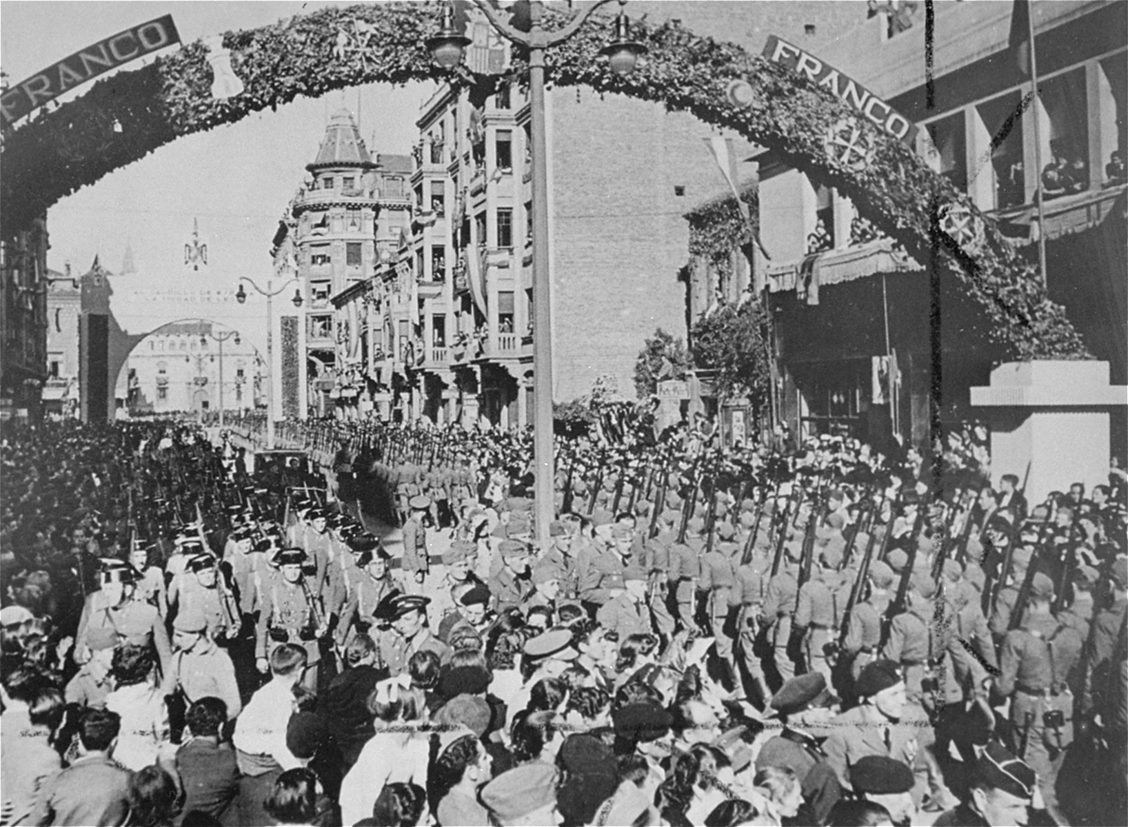 German troops, sent to Spain to aid Franco in his fight against Republican forces, march through a Spanish city.