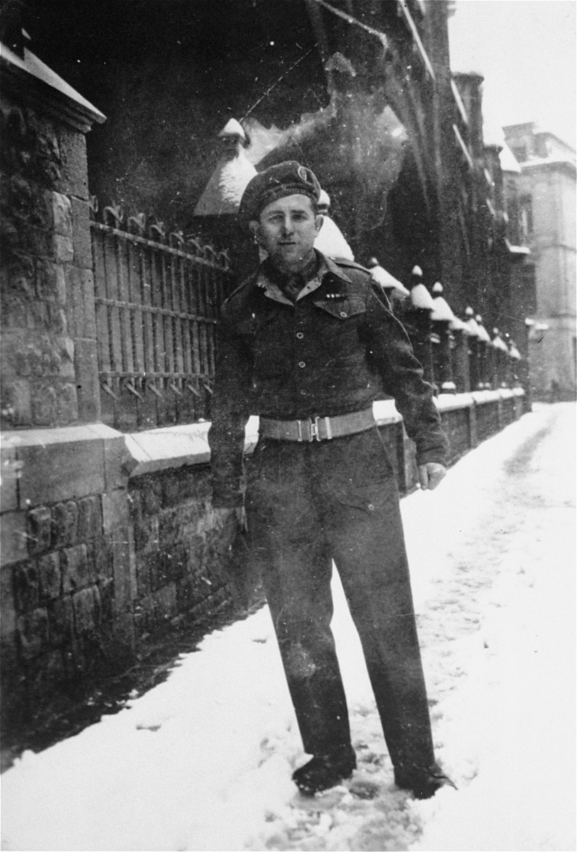 Portrait of one of the Jewish Brigade soldiers who accompanied members of the Kibbutz Buchenwald hachshara to Palestine, on [Oostenstraat] a street in Antwerp, Belgium.