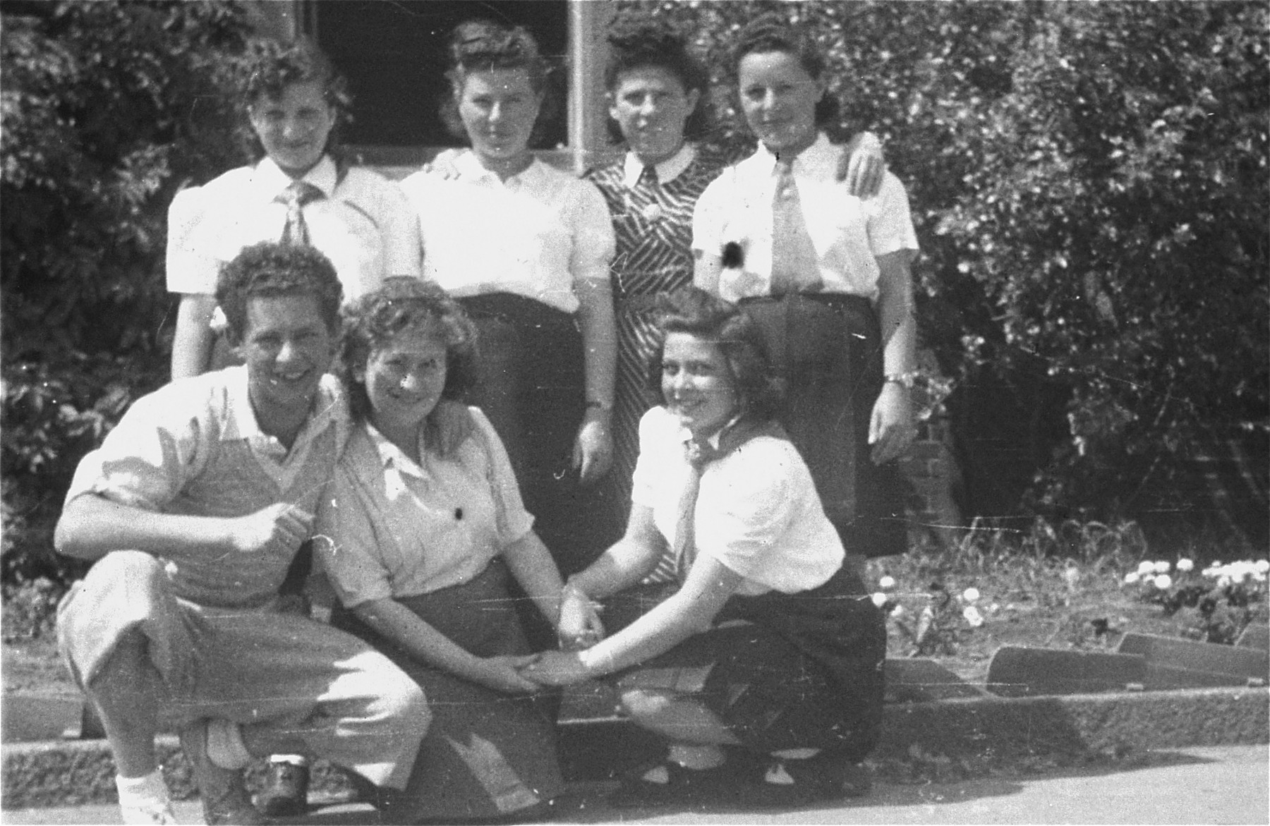 Group portrait of high school students in the Bergen-Belsen displaced persons camp.    Among those pictured is Rozia Merin (front row, far right) and Avram Pukacz (front row, left).