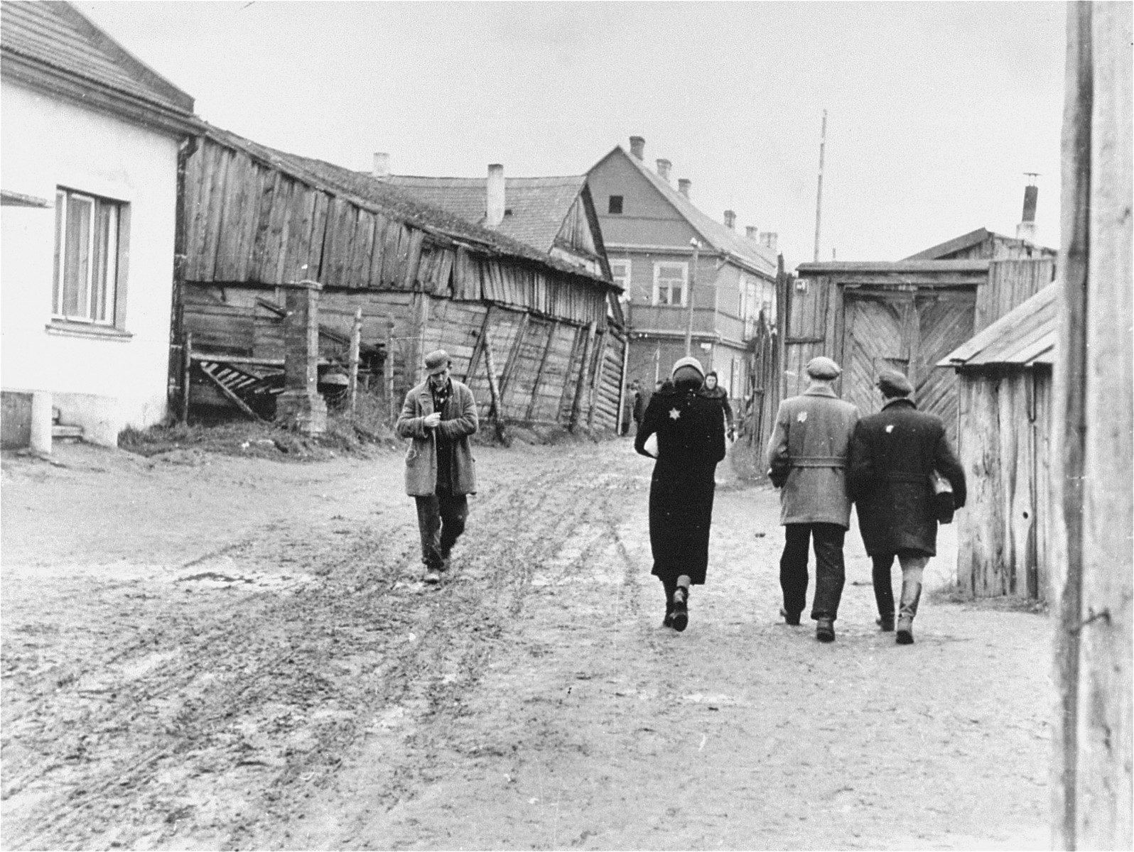 Street scene in the Kovno ghetto.    Pictured first on the right is Chaim Yellin. To his left is his friend, Pesach Shater.