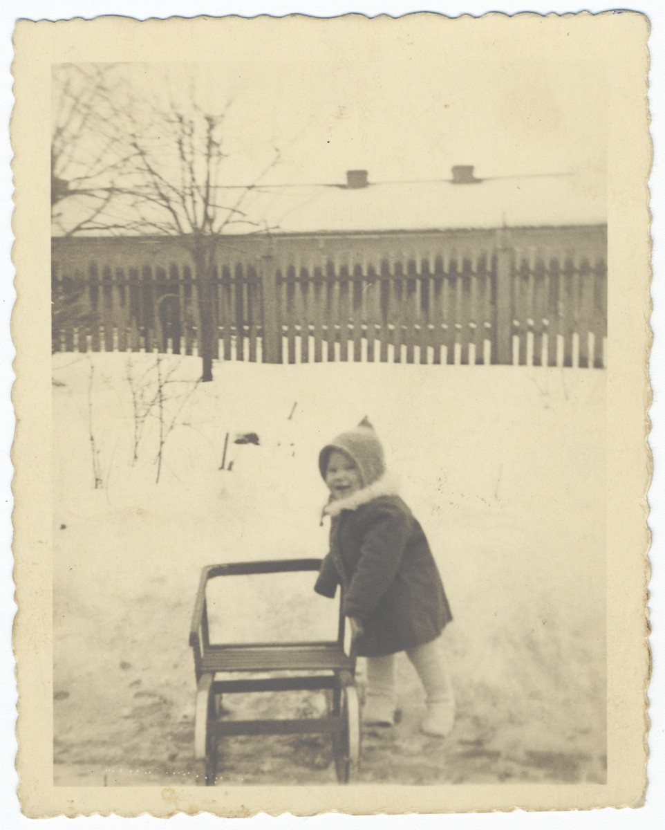 A young Jewish child plays outside in the snow shortly before the creation of the Krakow ghetto.  Pictured is Stefania Hoffman.