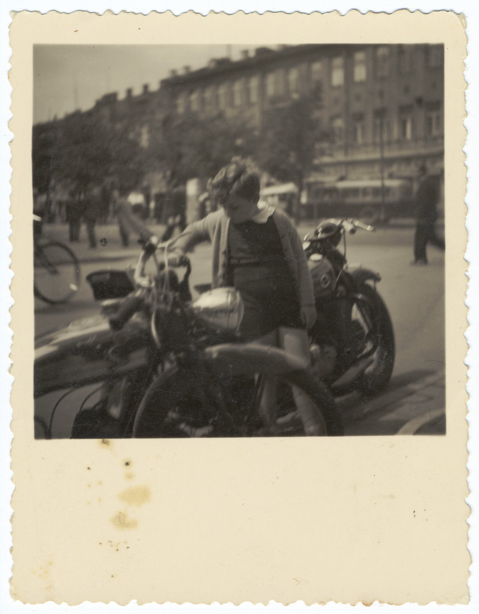 Simon Frumkin examines a German motorcycle in his father's dealership in downtown Kaunas.