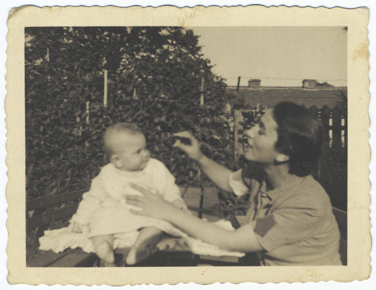 A Jewish mother plays with her newborn child in the year following the German invasion of Poland but prior to the establishment of a ghetto in Krakow.  Pictured are Regina and Stefania Hoffman.