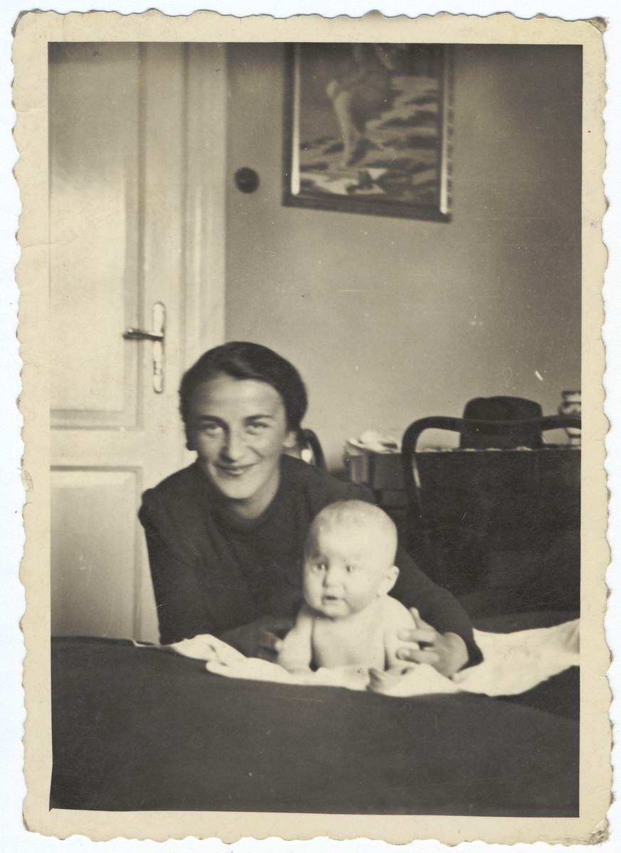 A Jewish mother poses with her newborn daughter inside their home in Krakow prior to the creation of the ghetto.  Pictured are Regina and Stefania Hoffman.