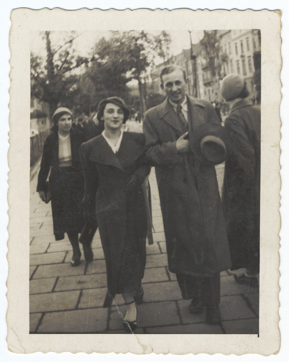 A Jewish couple walks down a street in Krakow.  Pictured are Rudolf and Regina Hoffman.