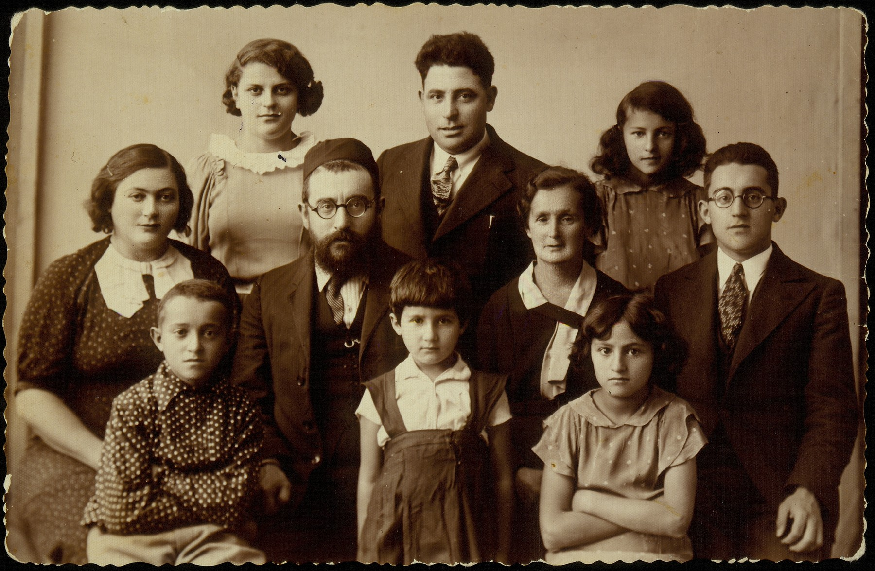 Hinski family portrait.   Rabbi Israel Yossef Hinski (middle row, third from right), was the last shamash of Eisiskes.  Also pictured are (top row, right to left) his daughter Golda-Brahah, his brother Yekutiel, niece Masha Hinski;  (middle row) son Alexander Zisl, Reb Israel's wife Taibe-Eidl (nee Kabacznik),  and his sister-in-law Esther Hinski; (bottom) daughter Hayya-Sheine, niece Golda Koppelman, and son Avraham-Yaakov.   Alexander Zisl immigrated to Palestine in 1939. Hayya-Sheine died a natural death during the summer of 1941.   All the others were murdered by the Germans during the September 1941 killing action in Eisiskes and elsewhere.
