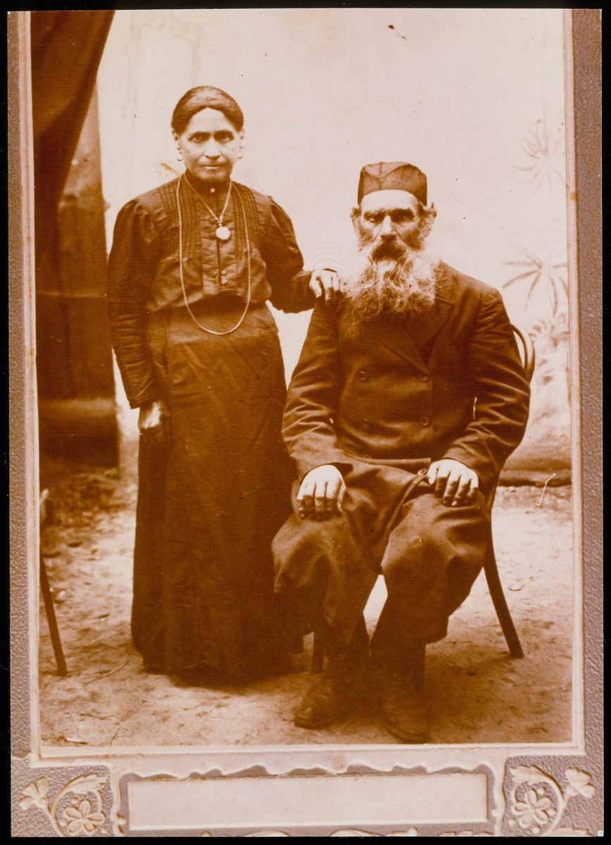 Studio portrait of an elderly, religious couple.  Shmuel and Dina (?) Ginunski were the grandparents of Luba Ginunski, the leading communist in Eisiskes.  They died before the war of natural causes.