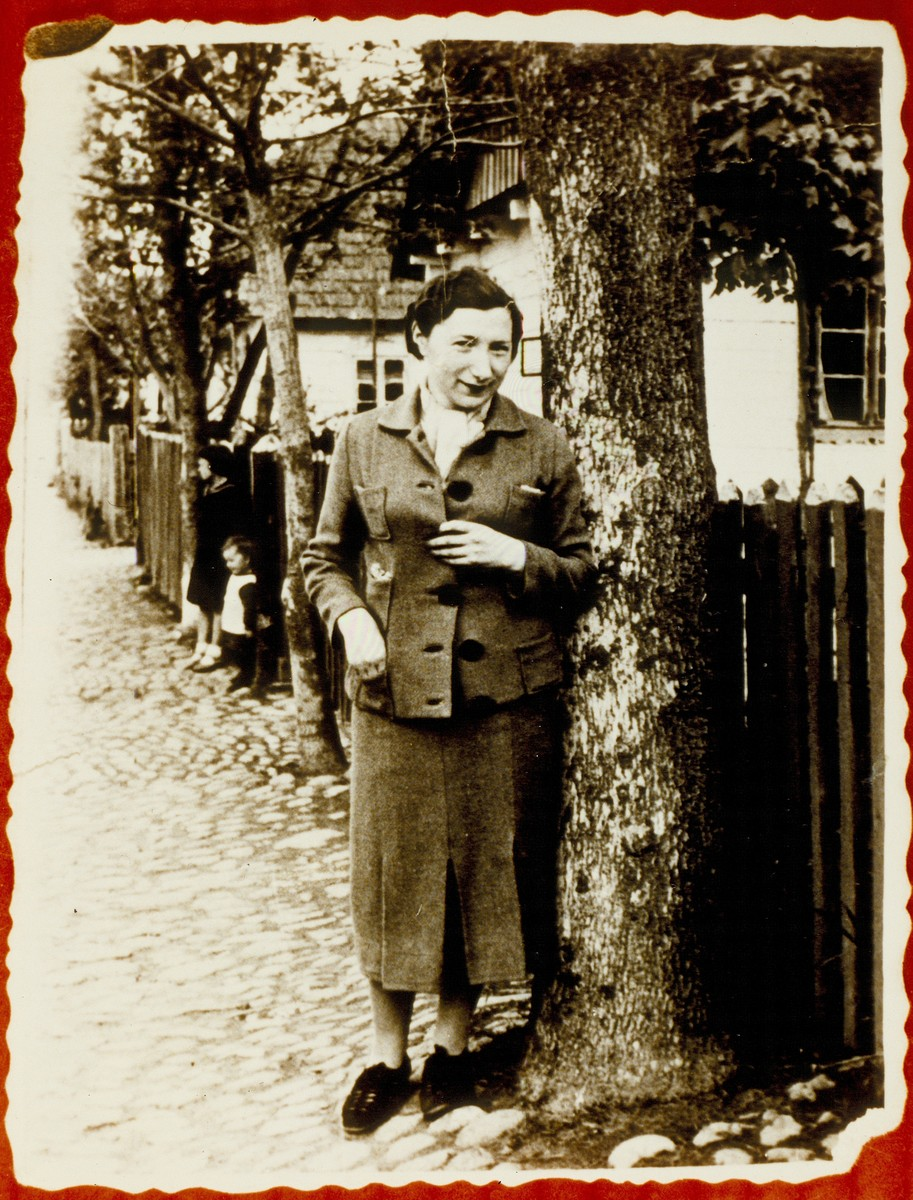 Szeina Blacharowicz stands near Shalom Sonenson's house on Vilna Street.    She survived the Holocaust hiding in the forest with the help of Polish peasants.