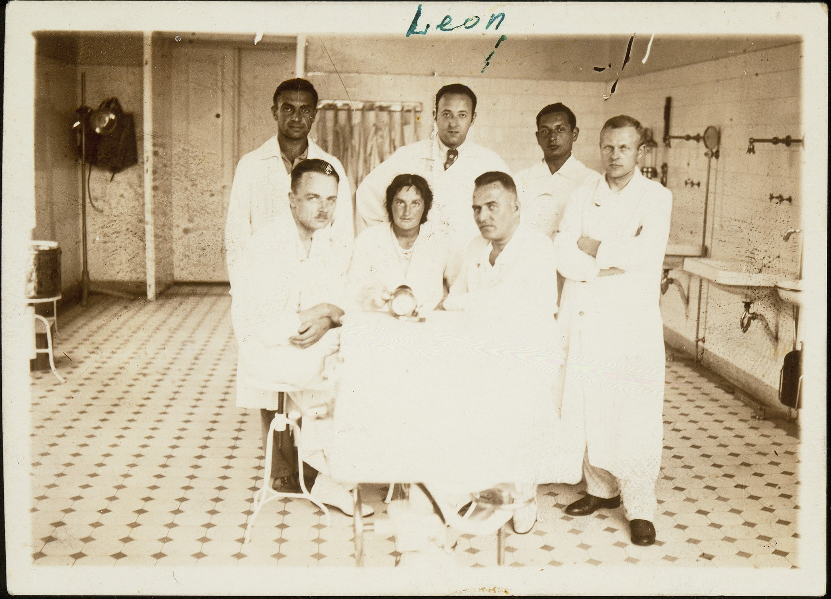 Dr. Leon Gordon (standing in the back, second from left) poses with a group of other medical personal at the surgical clinic in Vilna.  Dr. Leon Gordon served as a doctor in the Vilna ghetto and probably was murdered in Ponar.