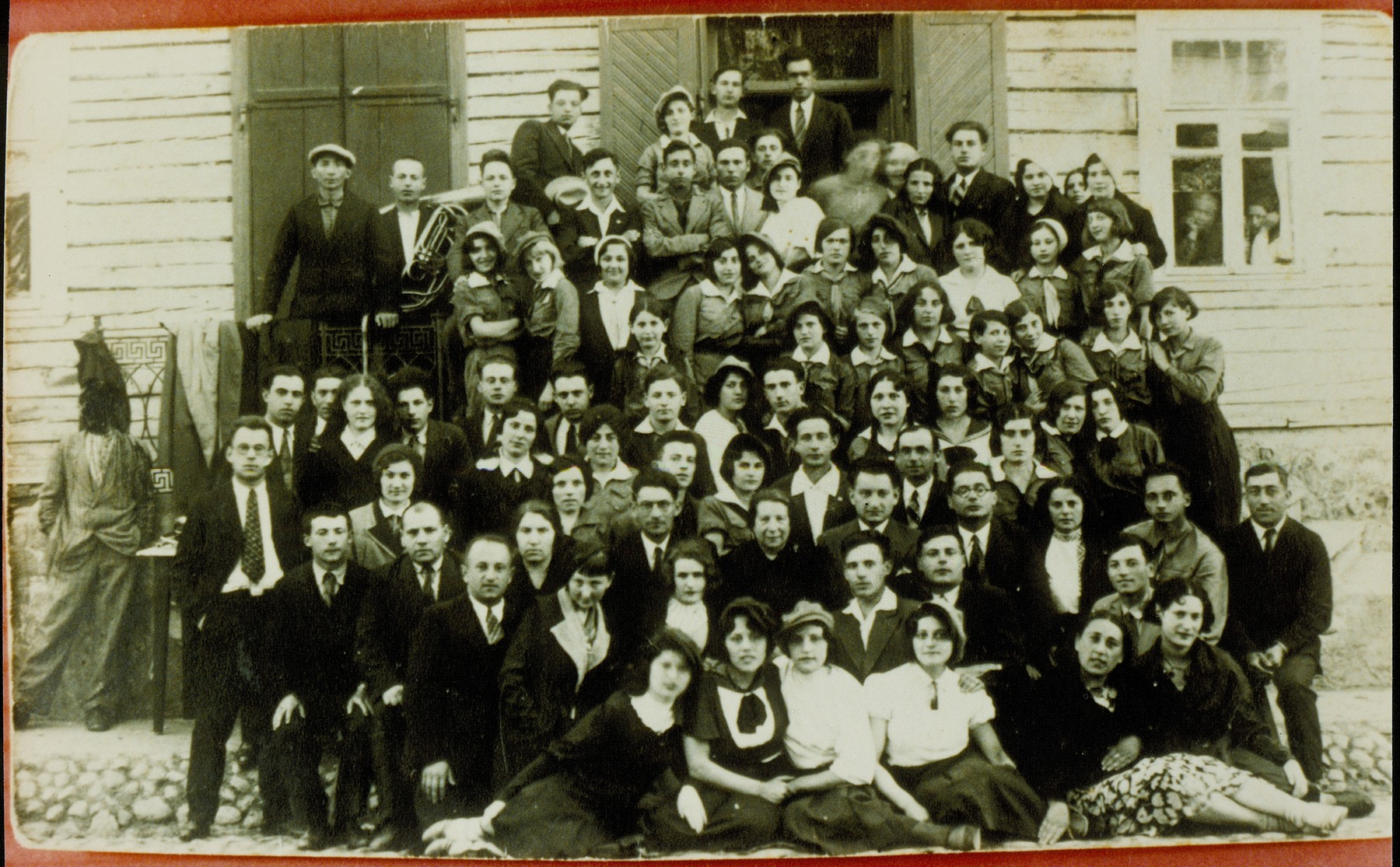 Members of the Hehalutz Zionist youth movement.  Flora Kagan is in the fourth row from the top, third person from the left.