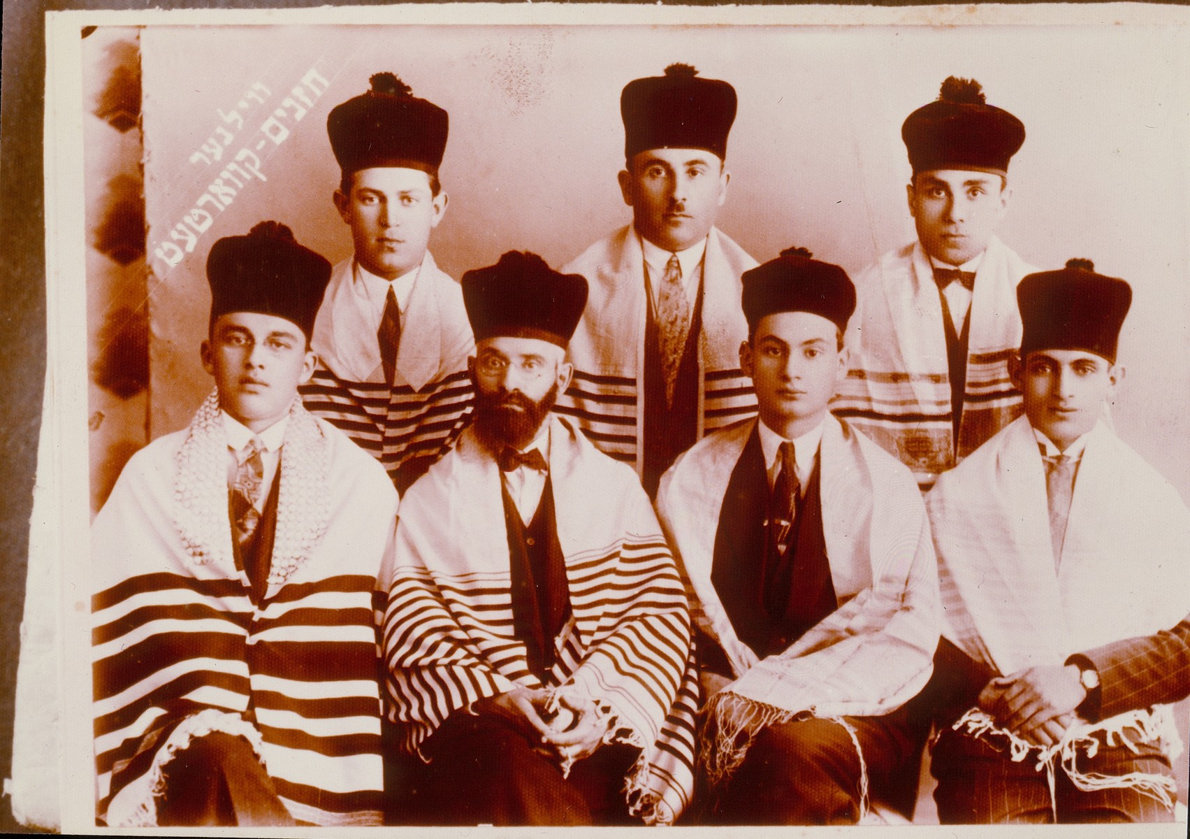 Group portrait of the members of the Vilna Hazzanim (cantors) Quartet, which continued to be known as such even after it expanded.  Among those pictured is Akiva Durmashkin (first row, second from the left).  Durmashkin was a prominent Vilna musician, music teacher and director of the choir of the Great Synagogue.  He was in the Vilna Ghetto and was killed on Ponary.