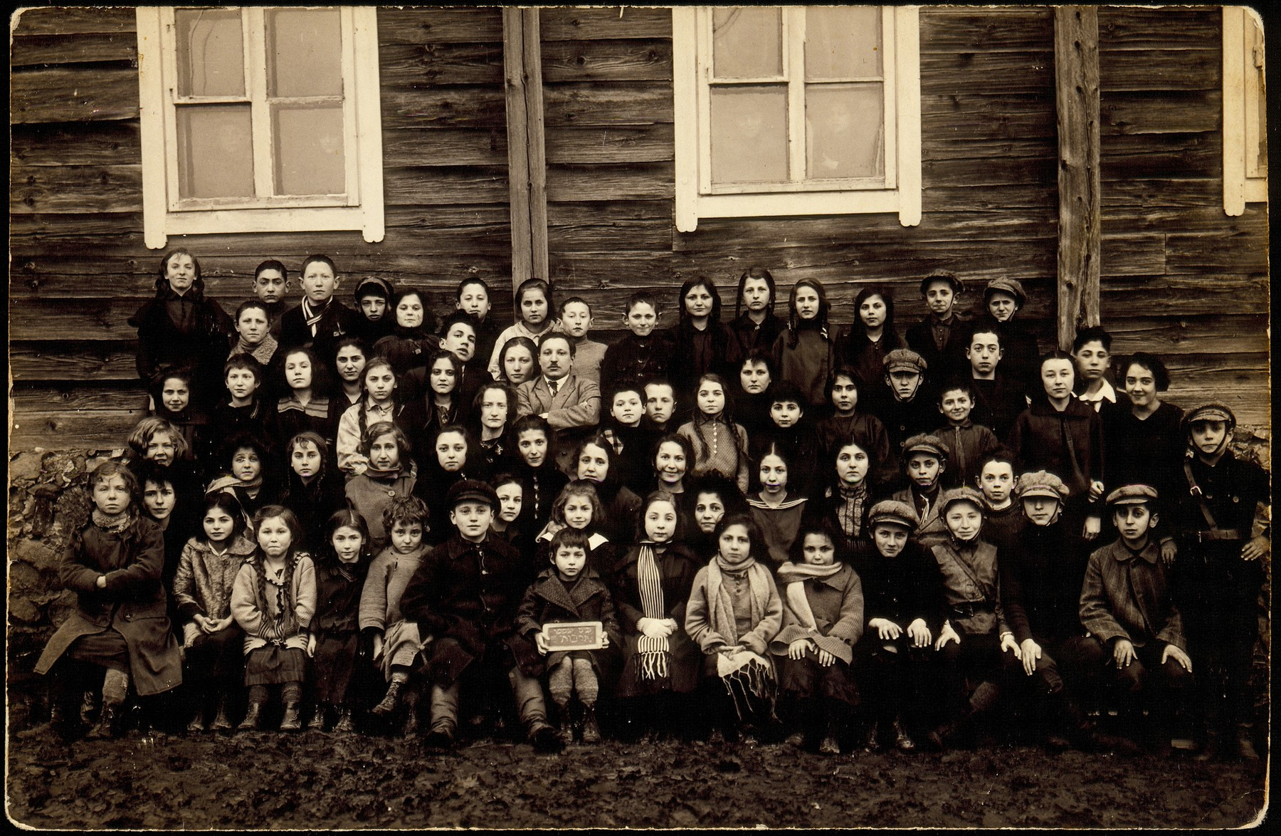 Students of the Tarbut school in Eisiskes.   The teacher, Mr. Pitochowski is sitting with his arms crossed.