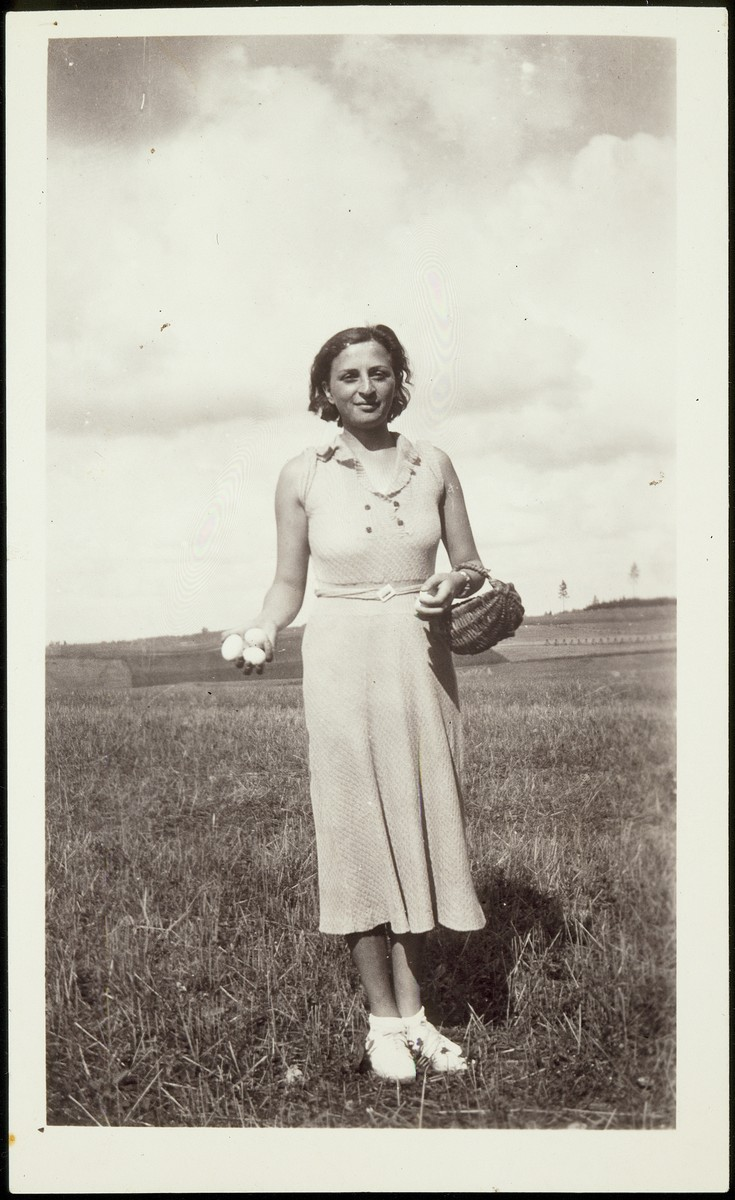 Rosalind Foster carries a basket of fresh eggs during her visit to Eisiskes from America.