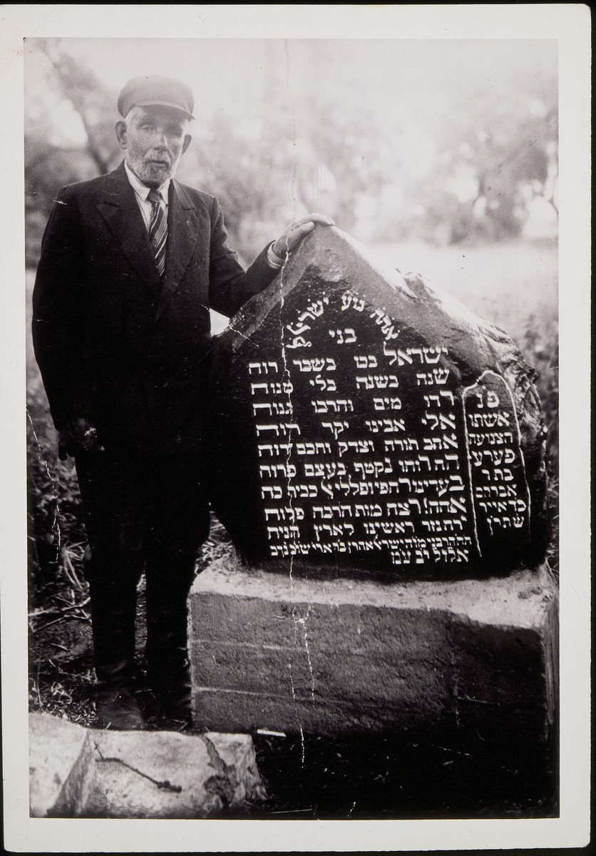 Shlomo Portnoy poses by the grave of a relative.