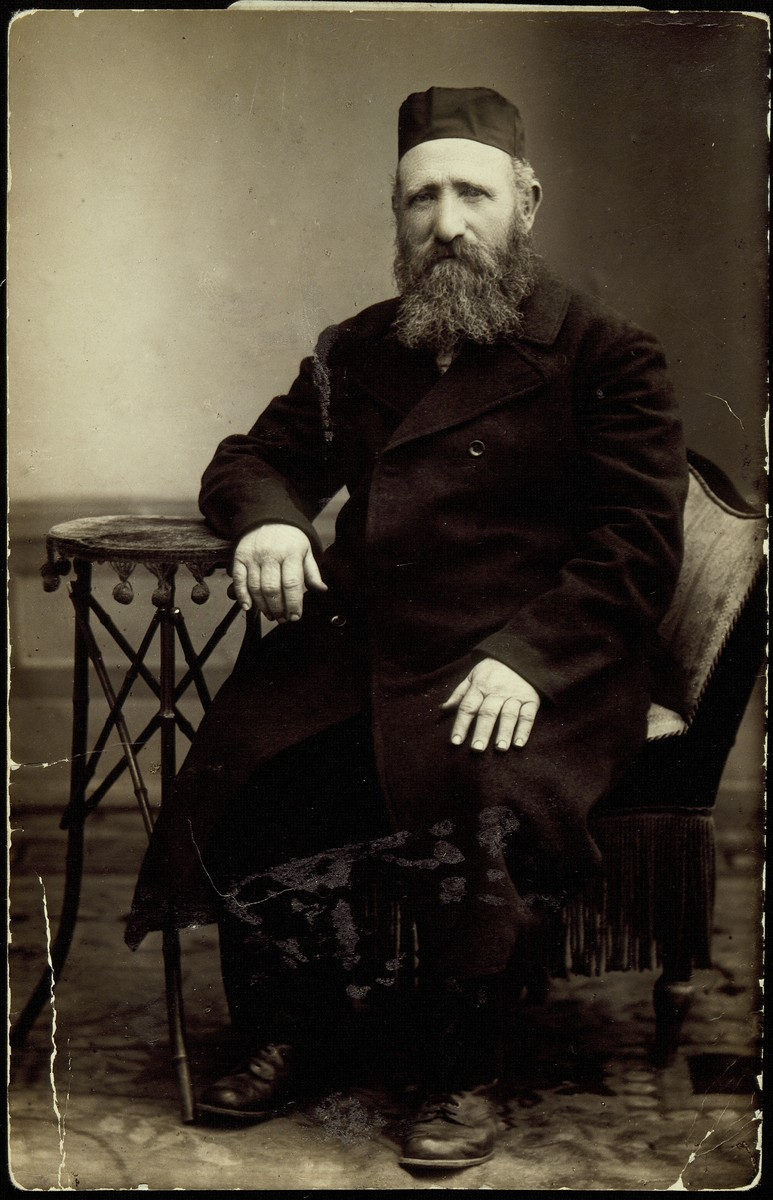 """Studio portrait of Jewish businessman Reb Reuven Kaganov.  Reb Reuven Kaganov worked in the flour business in Eisiskes and was known by his Polish nickname """"bialy zyd"""" (white Jew).  He died a natural death prior to the German occupation of Eisiskes."""