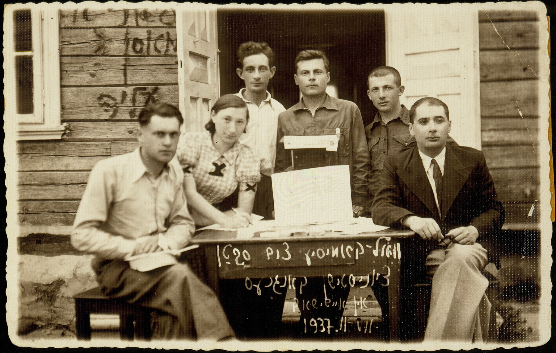 Six members of the election commission of Haoved Hatzioni in Eisiskes assist in fundraising for the 20th World Zionist Congress.    (from right to left) Eli Politacki, Shuster, Shalom Kahn, Israel Szczuczynski, Szeina Blacharowicz, and Yankl Levin.  They had hoped that the Congress would influence the British to open up Palestine for mass immigration.  None of the six was able to obtain an immigration certificate to Palestine.  Szeina survived the war in the forest; the others were murdered.