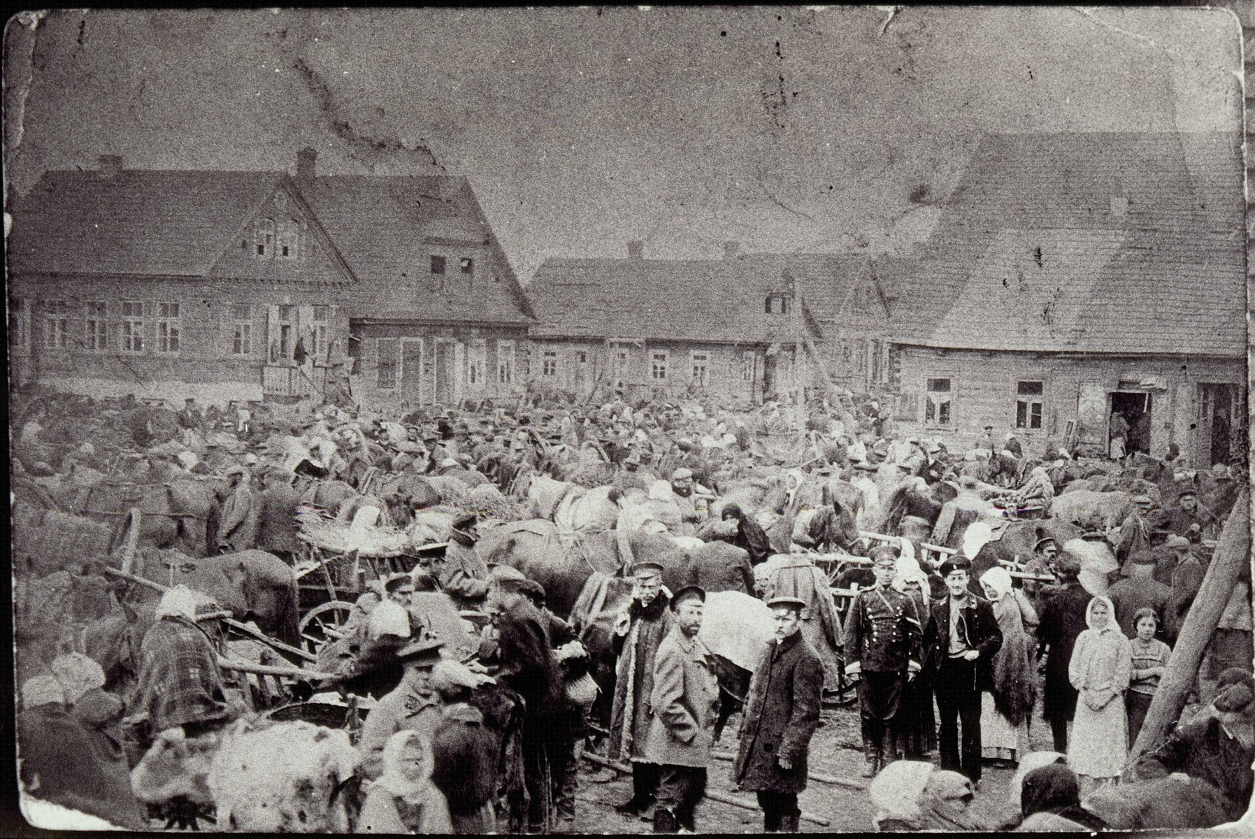 View of the townspeople and horse-drawn wagons in the outdoor market in Eisiskes prior to World War I.  The photo was mailed to a relative in America.