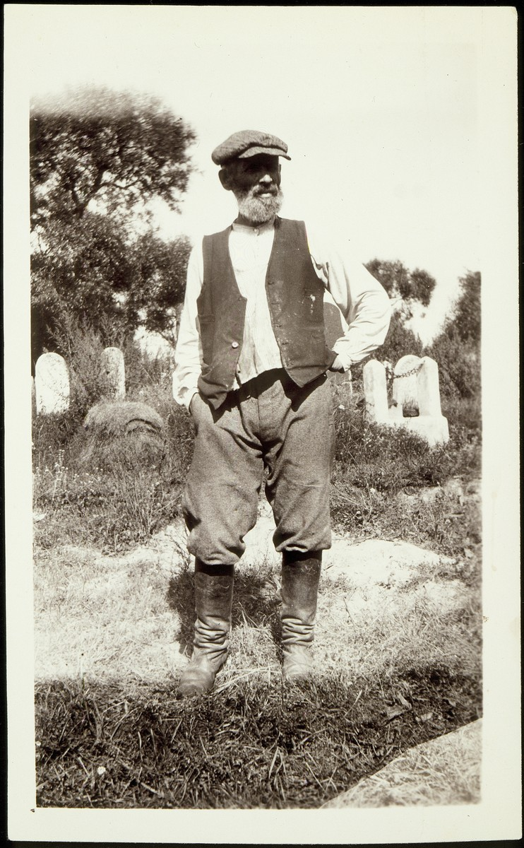 Nahum Szulkin, the shtetl's last undertaker, stands in the Eisiskes cemetery.   Szulkin was murdered by the Germans in the September 1941 mass killing action in Eisiskes.