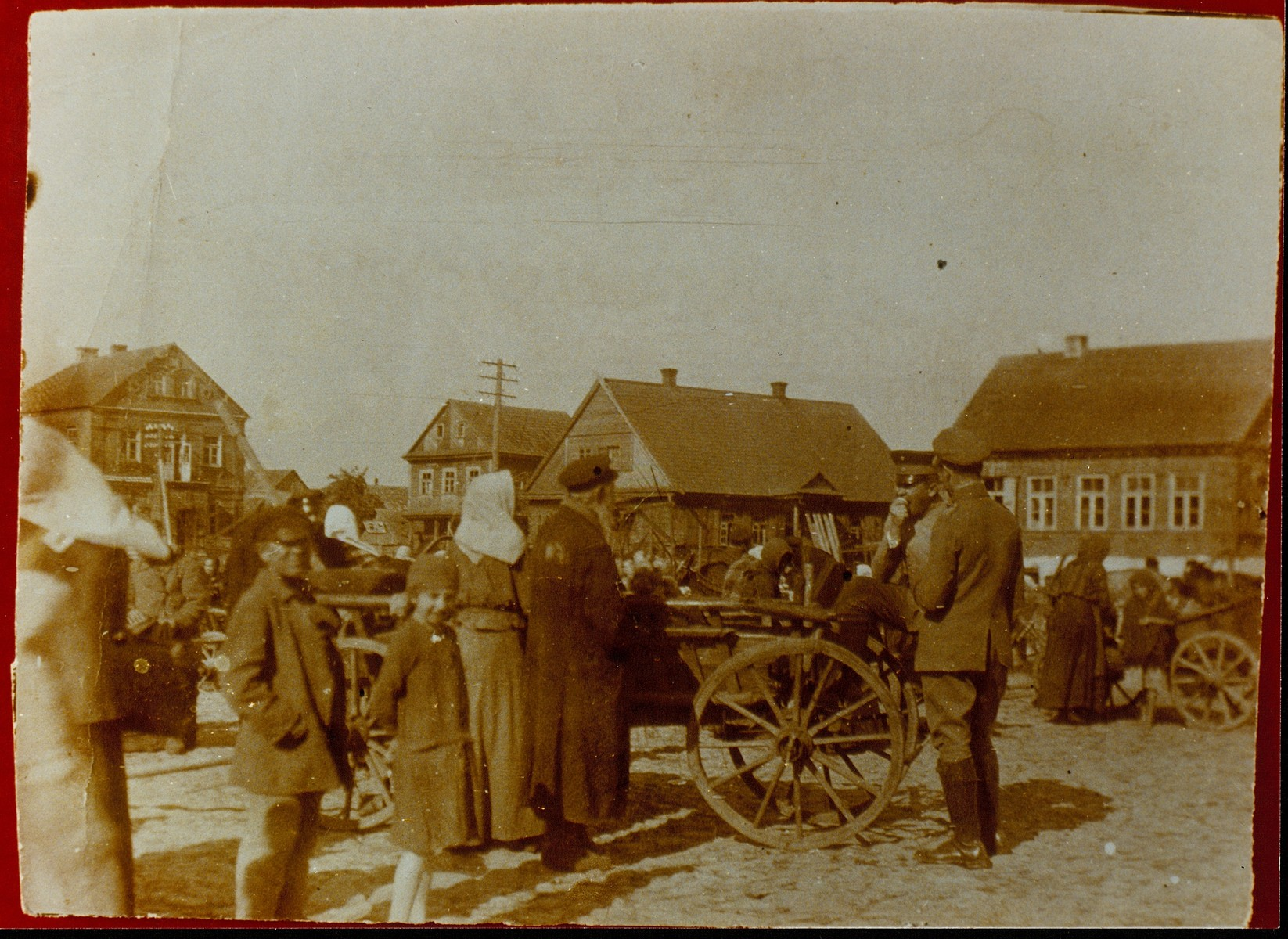 Peasants and town people shop at the central market square in Eisiskes during the German occupation of World War I.