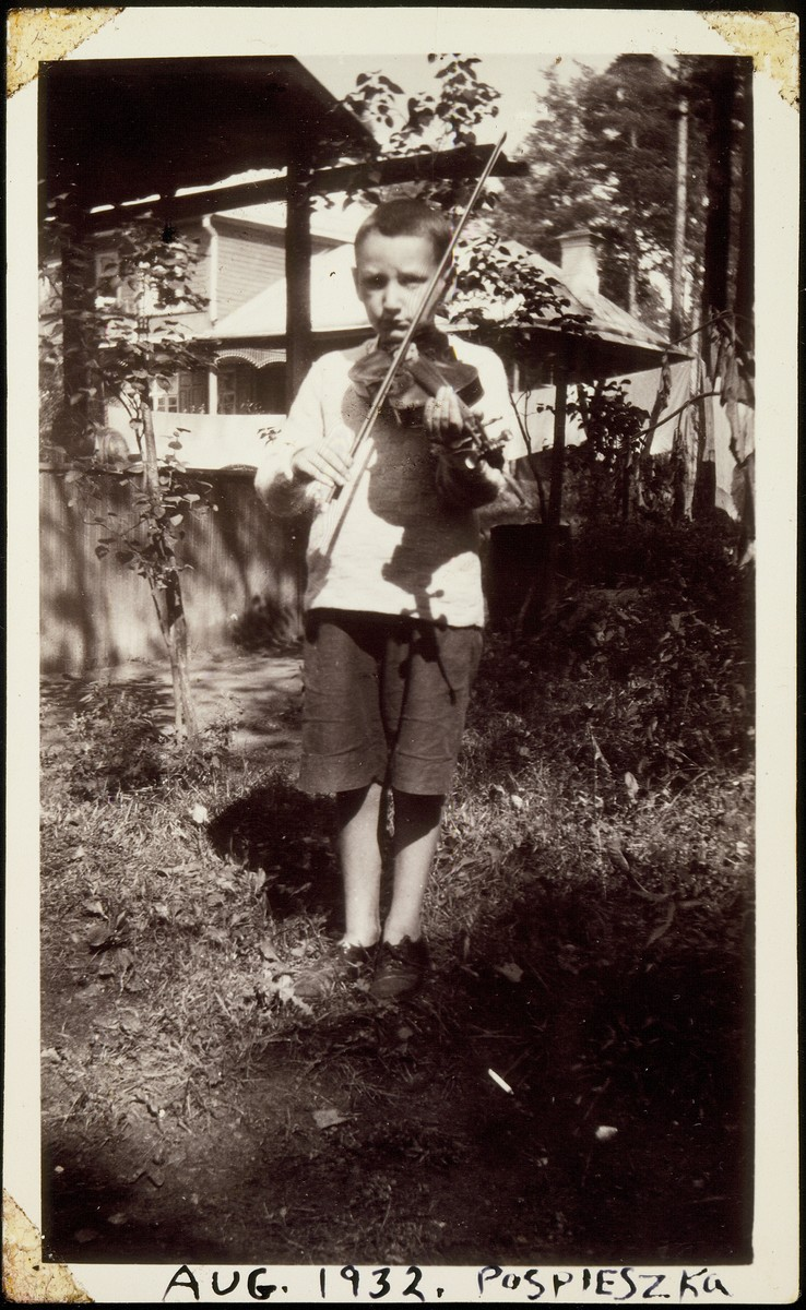 Lova Saposnikow plays his violin near his home outside of Vilna.   Lova was the son of Sonia Saposnikow.  He perished during the Holocaust