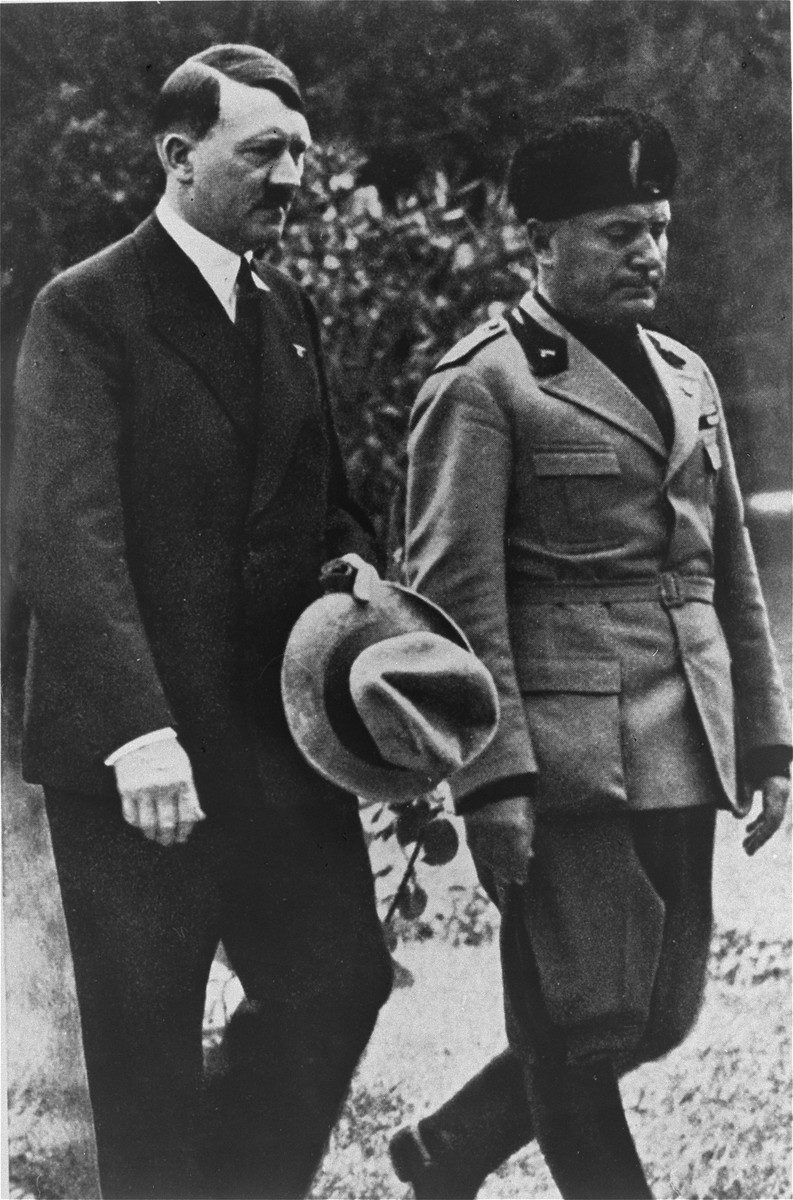 Adolf Hitler walks with Benito Mussolini during the German Chancellor's official visit to Italy.
