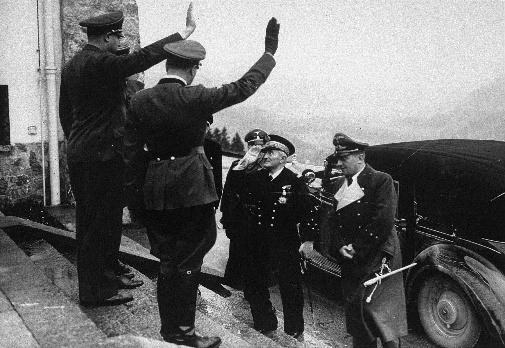Adolf Hitler salutes Admiral Francois Darlan upon his arrival at the Berghof.   Admiral Darlan was assassinated in December 1942 by a member of the French resistance.
