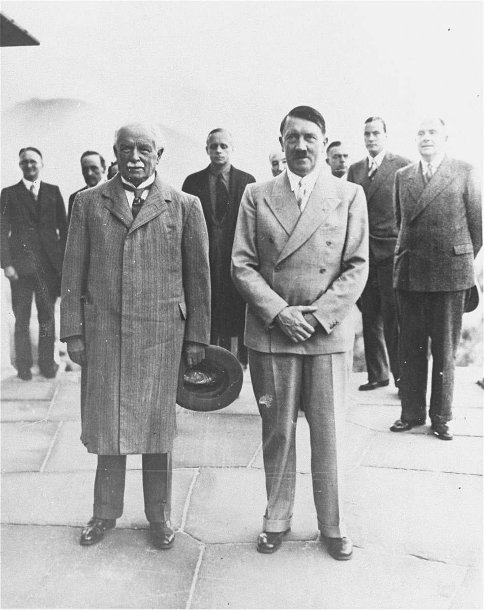 Former British Prime Minister David Lloyd George and  Adolf Hitler pose for a photograph on the Obersalzburg during George's second visit with the German Chancellor. German Foreign Minister Joachim von Ribbentrop is visible in the rear between the two leaders.