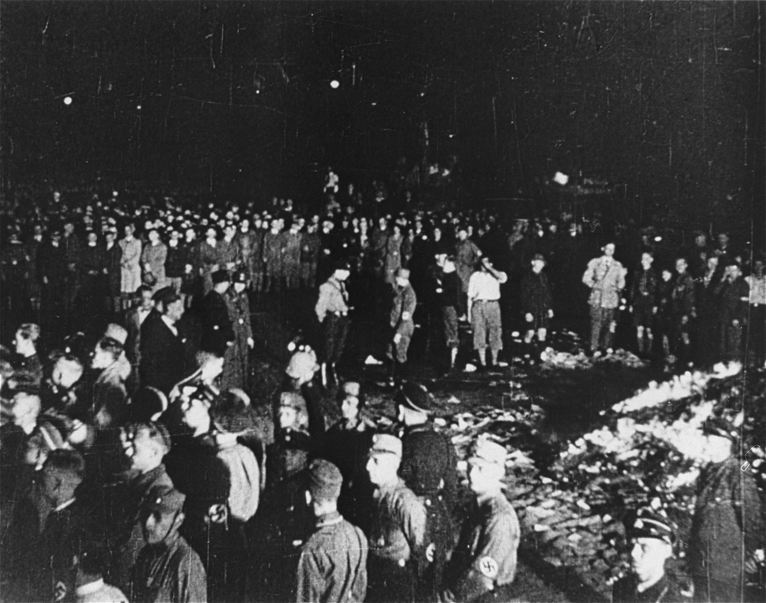 "The public burning of ""un-German"" books by members of the SA and university students on the Opernplatz in Berlin.   Still from a motion picture."