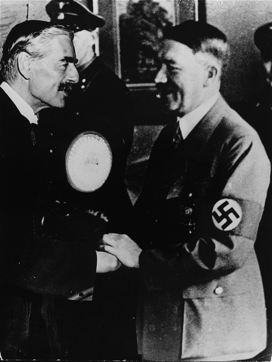 Adolf Hitler greets Neville Chamberlain upon the British Prime Minister's arrival in Munich.