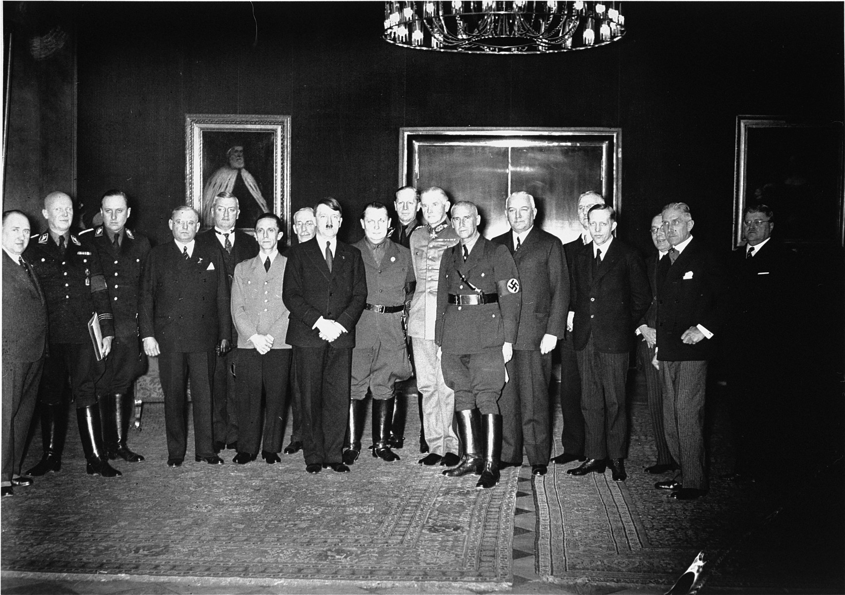 Adolf Hitler poses with members of his new government soon after his appointment as Chancellor.  Standing (from left to right) are Walther Funk, Hans Heinrich Lammers, Walther Darre, Franz Seldte. Franz Guertner. Joseph Goebbels. Paul von Eltz-Ruebenach, Adolf Hitler; Hermann Goering, Kurt Schmitt, Werner von Blomberg, Wilhelm Frick, Constantin Freiherr von Neurath, Hjalmar Schacht, Lutz Graf Schwerin von Krosigk, Johannes Popitz, Franz von Papen, and Otto Meissner.