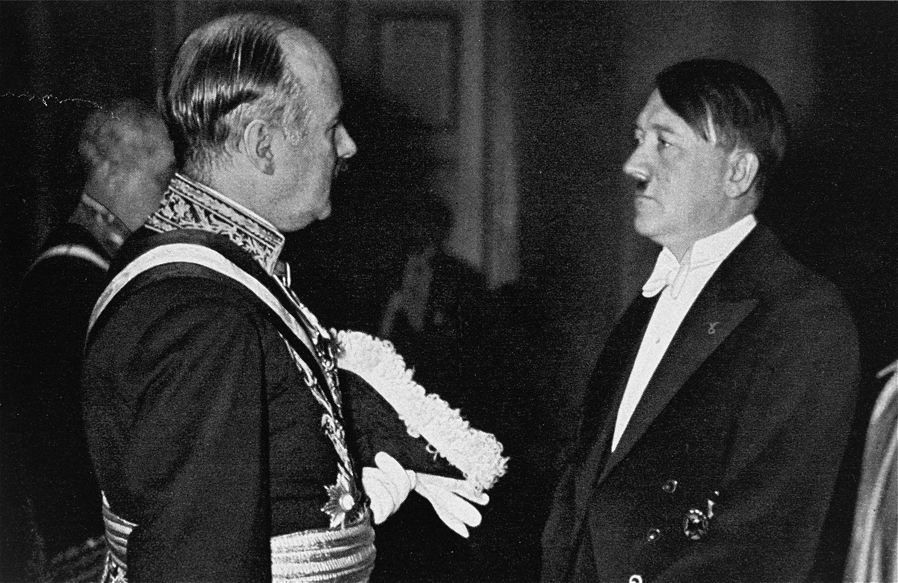 Adolf Hitler converses with French Ambassador Andre Francois-Poncet at a New Year's Eve reception.